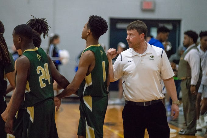 Acadiana's head coach Nic Jeffers talks to his players before the game as the Acadiana high school Rams take on the David Thibodaux Bulldogs on January 8, 2019.
