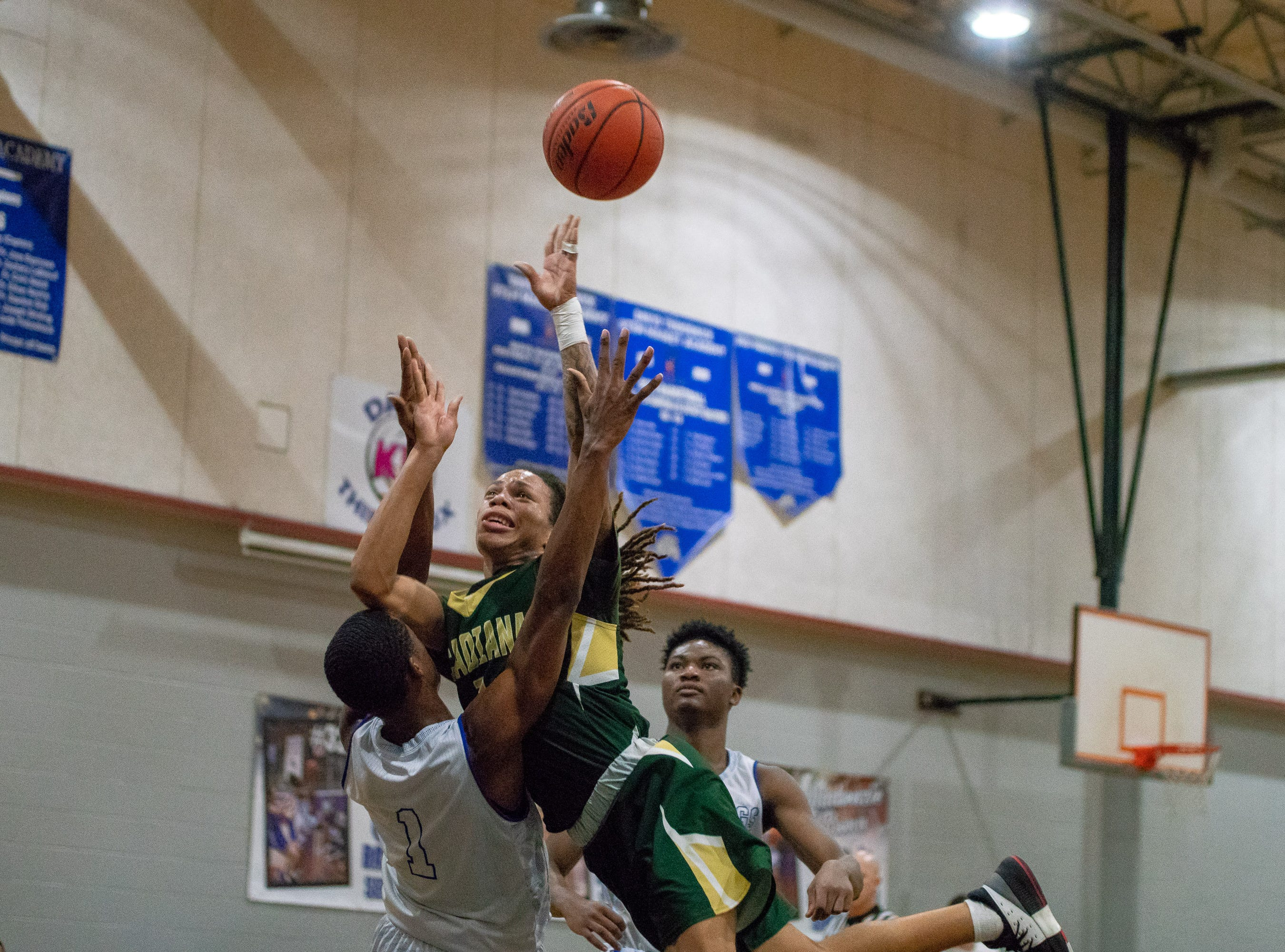 Acadiana's Dontreal Mouton drives to the basket to score  as the Acadiana high school Rams take on the David Thibodaux Bulldogs on January 8, 2019.