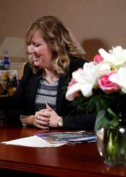 Kate Smiley Parker laughs as she talks at her desk Wednesday, Jan. 9, 2019, at Fairfield National Bank in Lancaster. Smiley Parker will receive the Tammy Nusser award at the Lancaster-Fairfield County Chamber of Commerce annual awards ceremony Jan. 19.