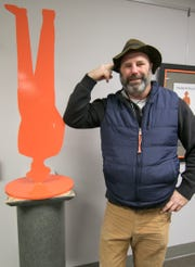 "Sculptor John Sauvé, shown Tuesday, Jan. 8, 2019, has installed a number of his ""Man in the City"" sculptures around the Cleary University campus as part of a retrospective show on his work."