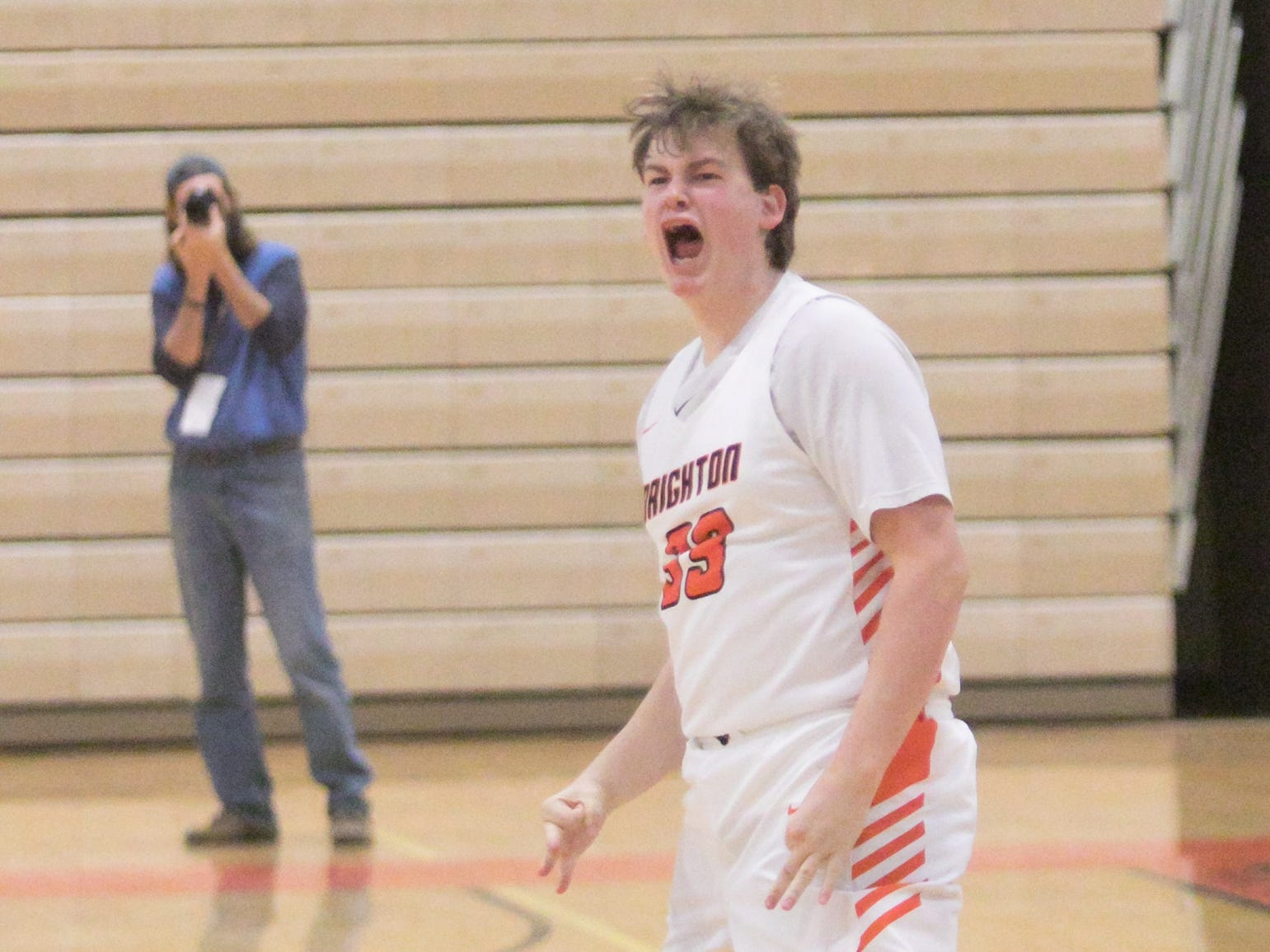 Brighton's Shane Armstrong celebrates his three-pointer just under the buzzer tying the score with Howell and prompting overtime Tuesday, Jan. 8, 2019.