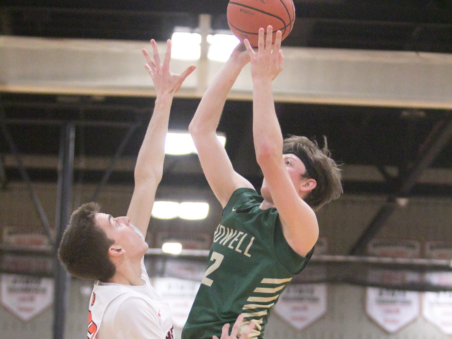 Luke Russo of Howell hits his target in the third quarter of the game at Brighton Tuesday, Jan. 8, 2019.