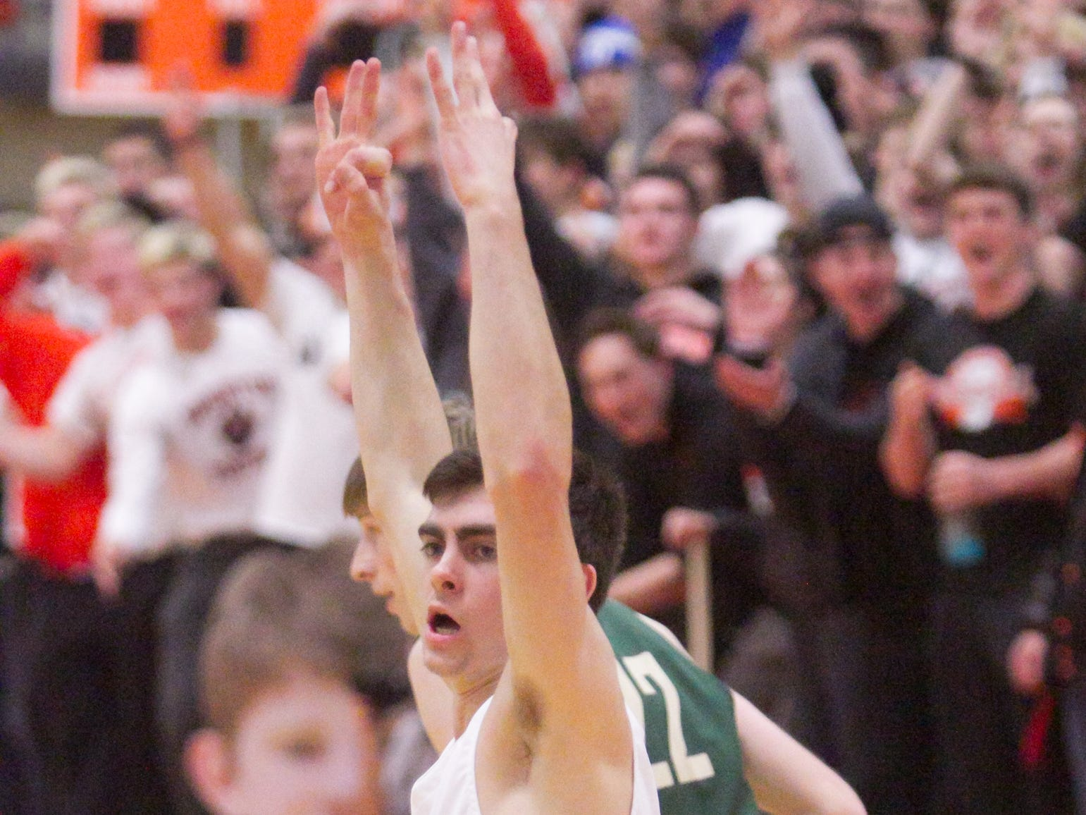Brighton's Nolan Ehman celebrates his three-pointer, putting the Bulldogs on the scoreboard in the first quarter of the game against Howell Tuesday, Jan. 8, 2019.