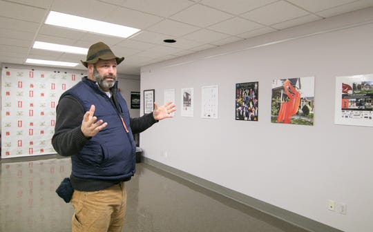 John Sauvé talks about his work Tuesday, Jan. 8, 2019 at Cleary University's Secunda Museum, highlighting his sculptures in a retrospective show across the campus.