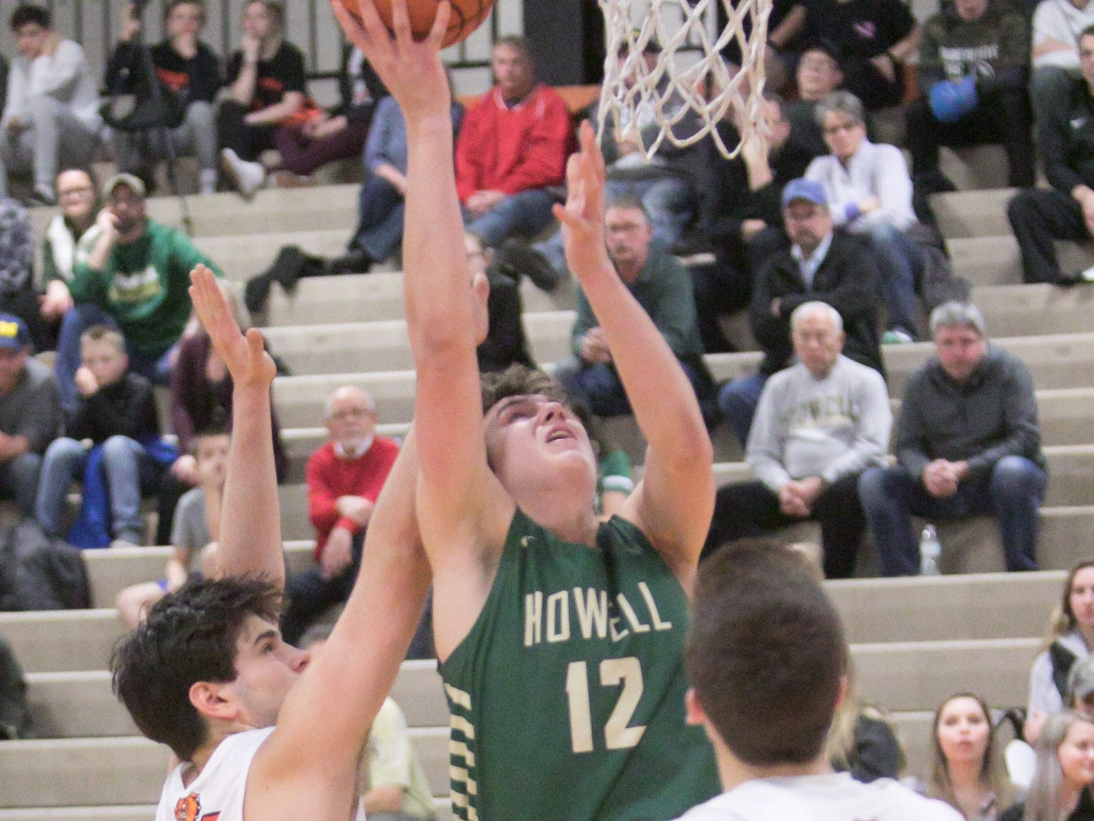 Howell's Tony Honkala makes a shot in the fourth quarter of a 65-63 overtime victory at Brighton on Tuesday, Jan. 8, 2019.