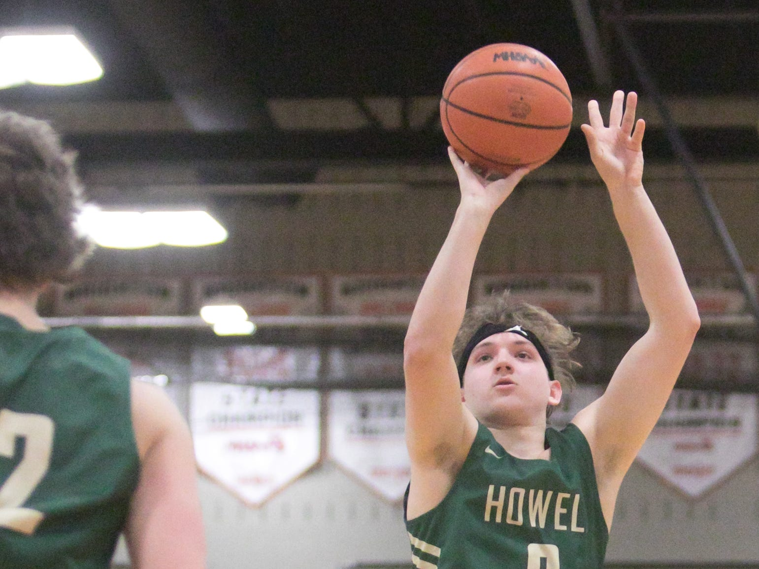 Josh Palo of Howell shoots in the third quarter of the game at Brighton Tuesday, Jan. 8, 2019.