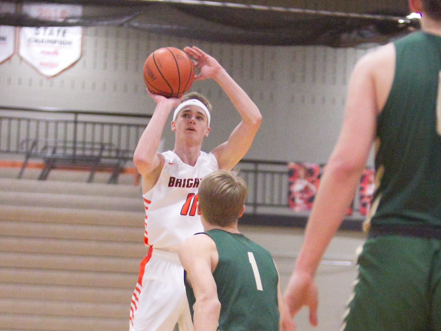 Jacob Dunn of Brighton hits a three-pointer in the game against Howell Tuesday, Jan. 8, 2019.