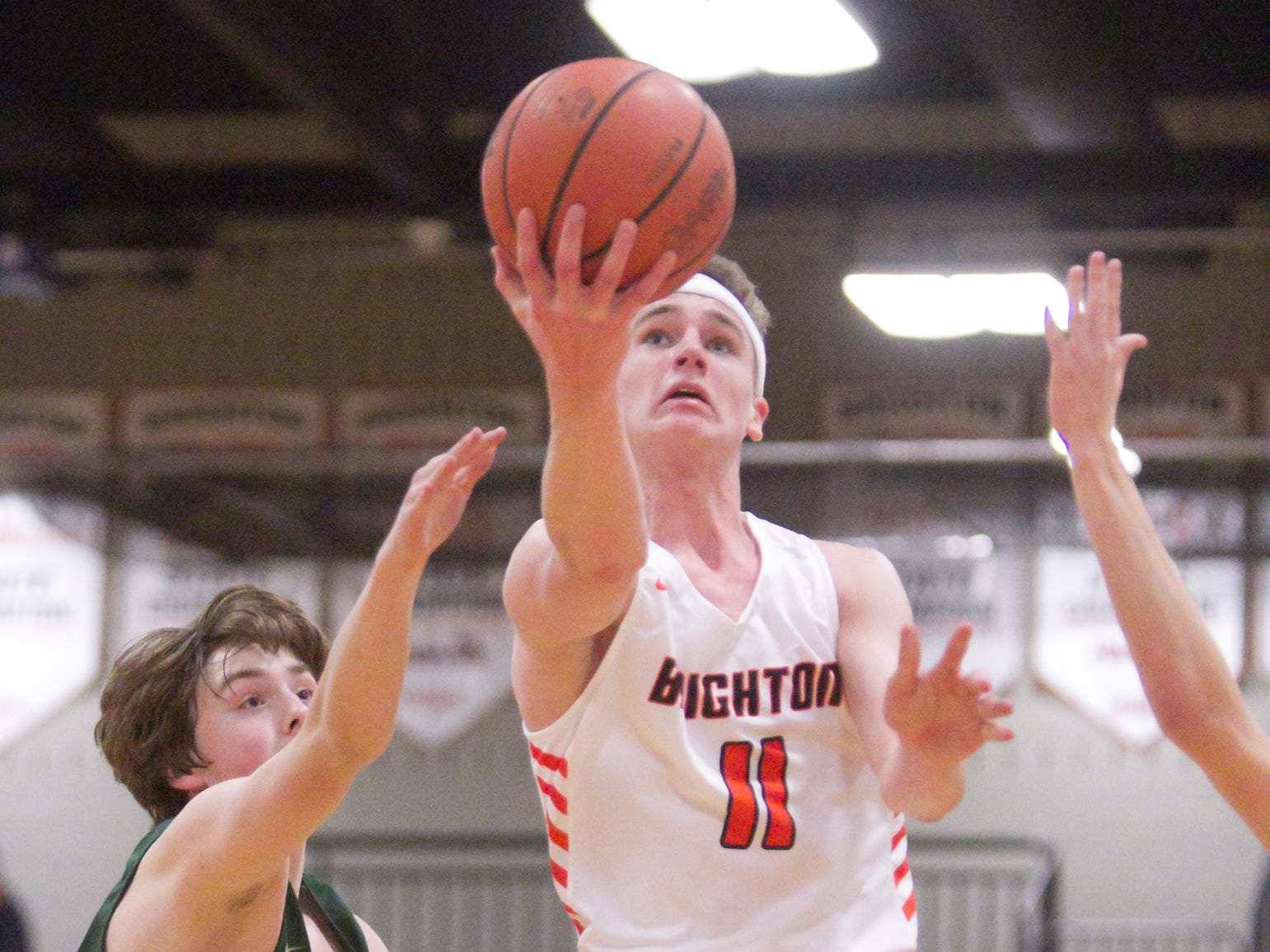 Brighton's Jacob Dunn shoots in the first quarter of the game against Howell Tuesday, Jan. 8, 2019.