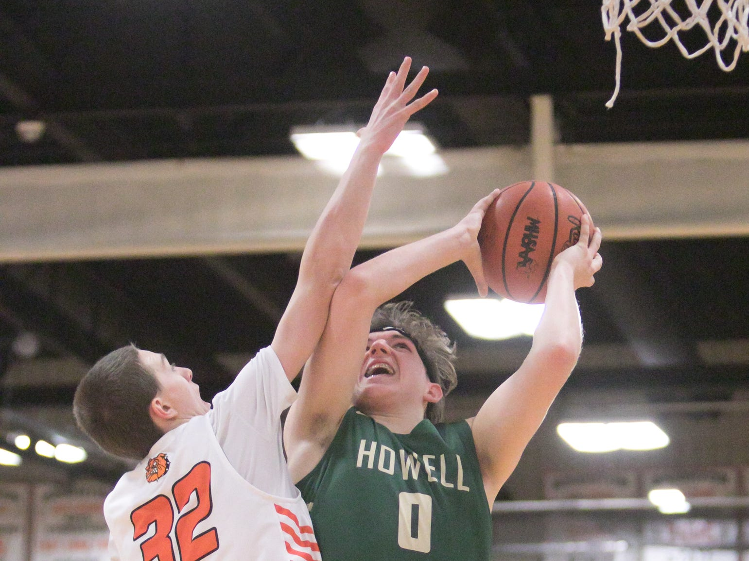 Howell's Josh Palo scores and is fouled by Brighton's Owen Ehman in the fourth quarter of the game at Brighton Tuesday, Jan. 8, 2019