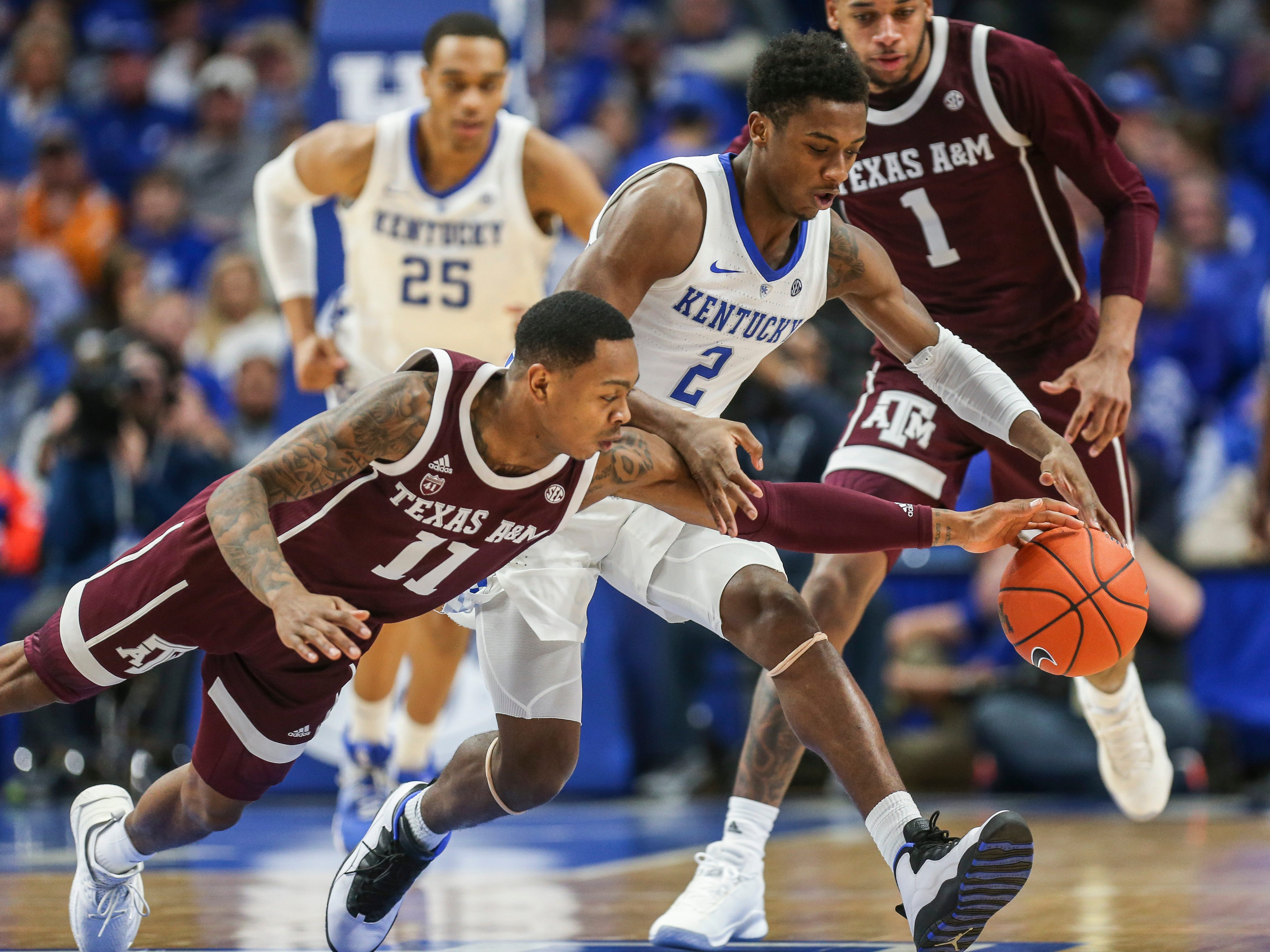Kentucky's Ashton Hagans pressures Texas A&M's Wendell Mitchell for the ball in the second half. Hagans finished with 18 points and five steals, including this one.  January 8, 2019