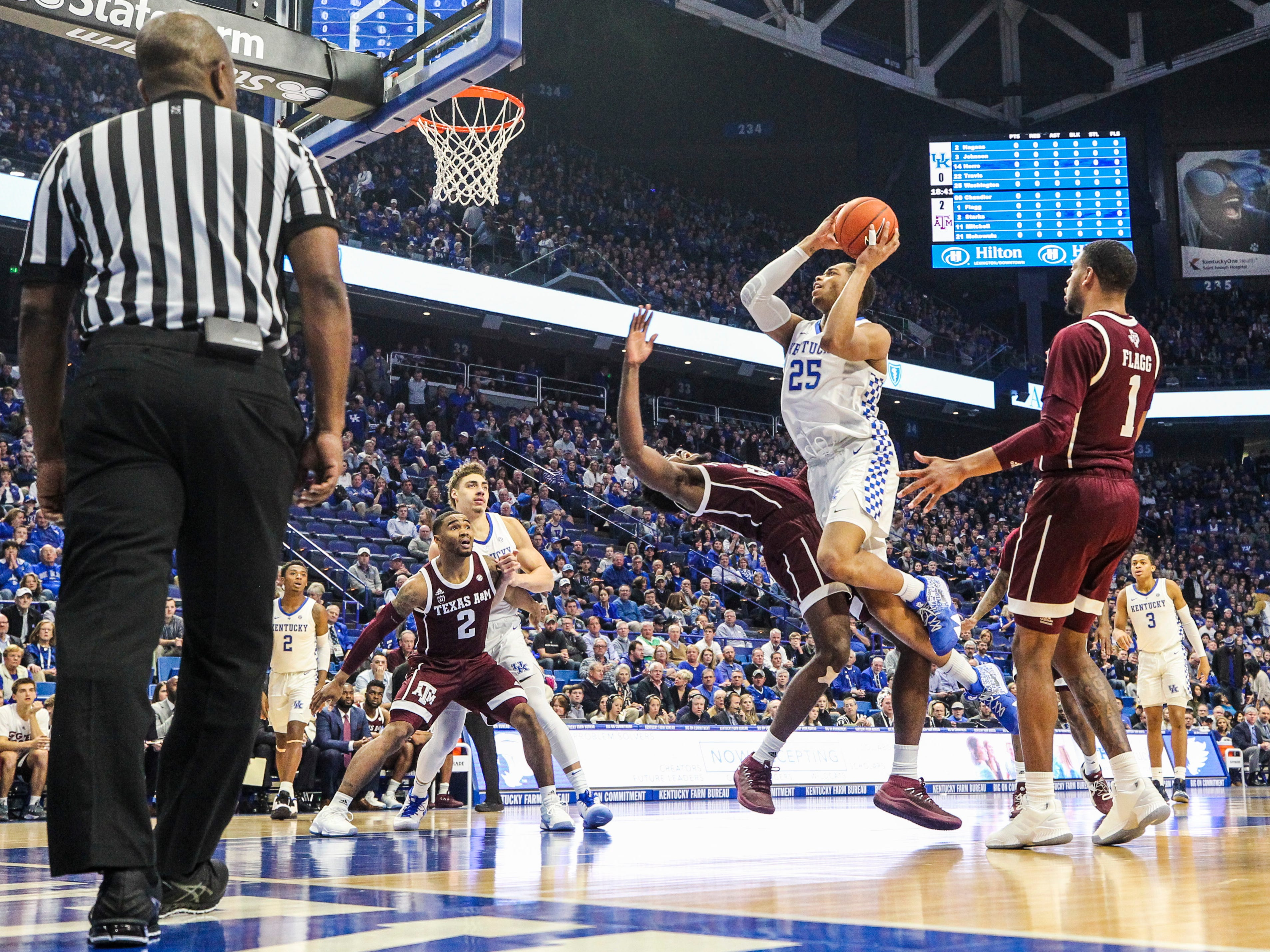 Kentucky's PJ Washington, Jr. tries to muscle past the Texas A&M's Christian Mekowulu in the first half Tuesday night at Rupp Arena in Lexington.