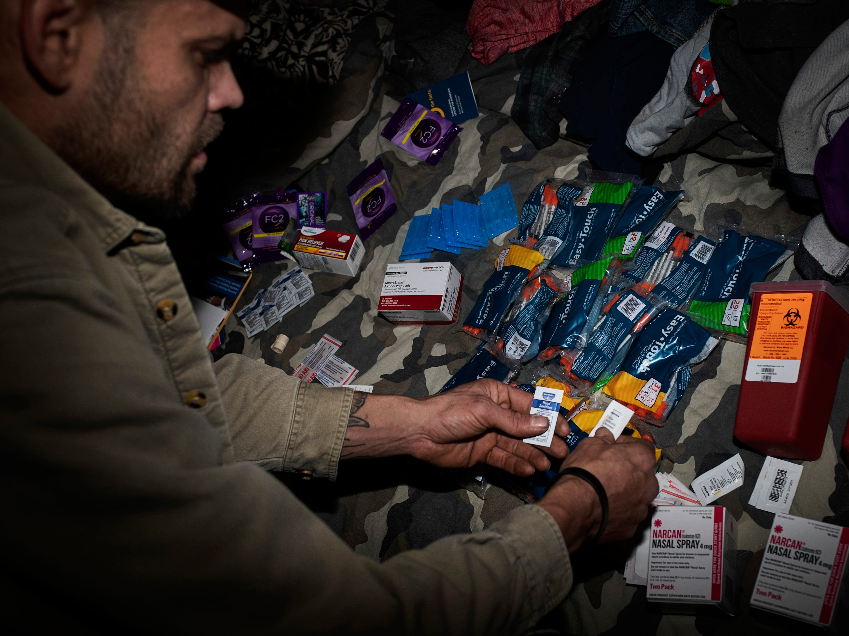 "Austin resident Matt Hensley goes through the supplies that he received from the Scott County Syringe Service program. Hensley began using in high school and has tried to quit using meth 13 times-to-date. ""I feel like I've spent half of my life being a nobody,"" Hensley said. ""The next half is going to define me."" The week prior, Hensley lost a longtime friend to a heroin overdose. The Scott County Syringe Service has saw the overall cases of HIV level off since the initial outbreak in 2015 and hopes that it can keep intravenous users like Hensley from contracting diseases. Nov. 30, 2018"