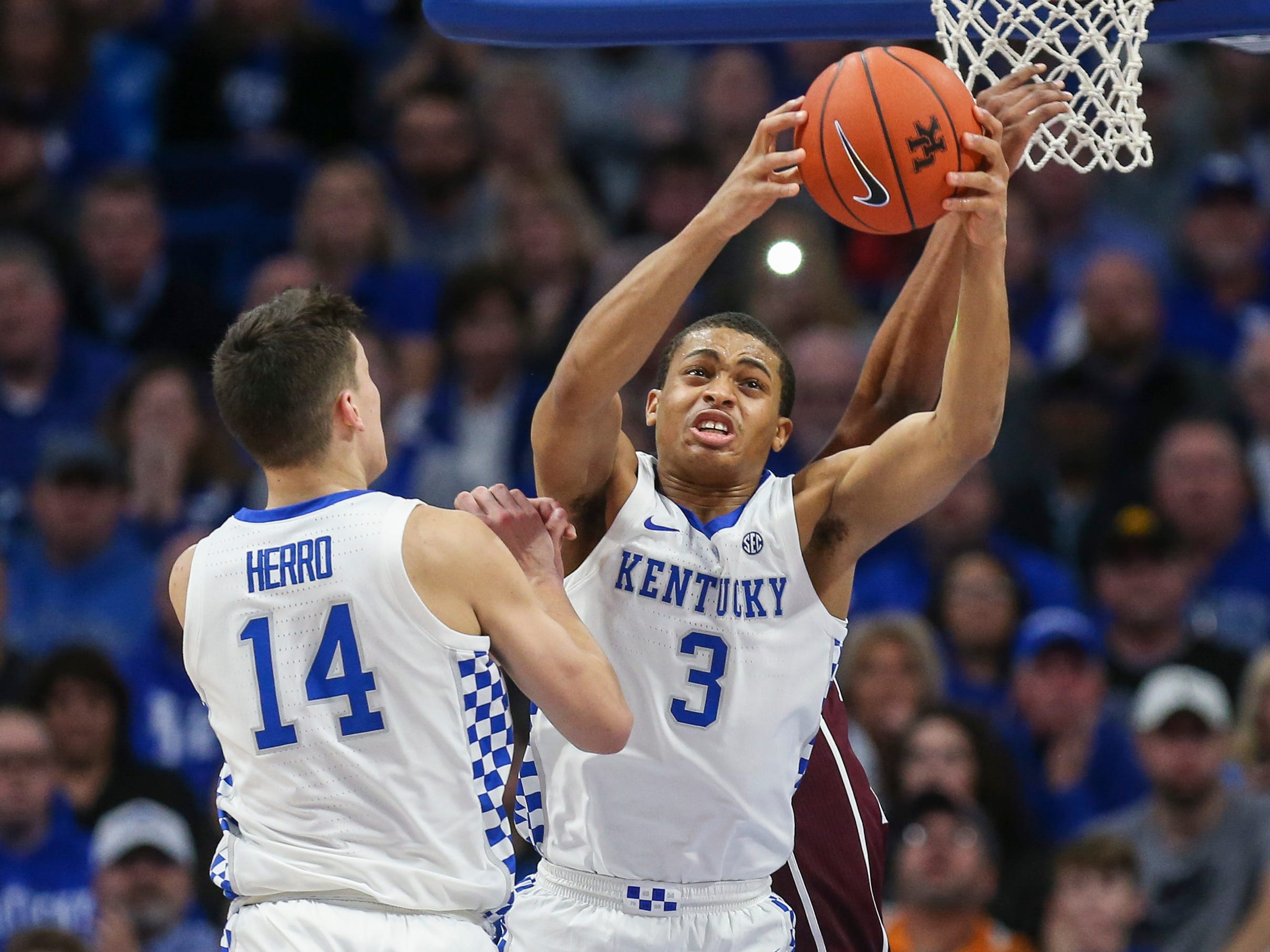Kentucky's Keldon Johnson grabbed one of his eight rebounds in the Cats' 85-74 win Jan. 8, 2019 at Rupp Arena.