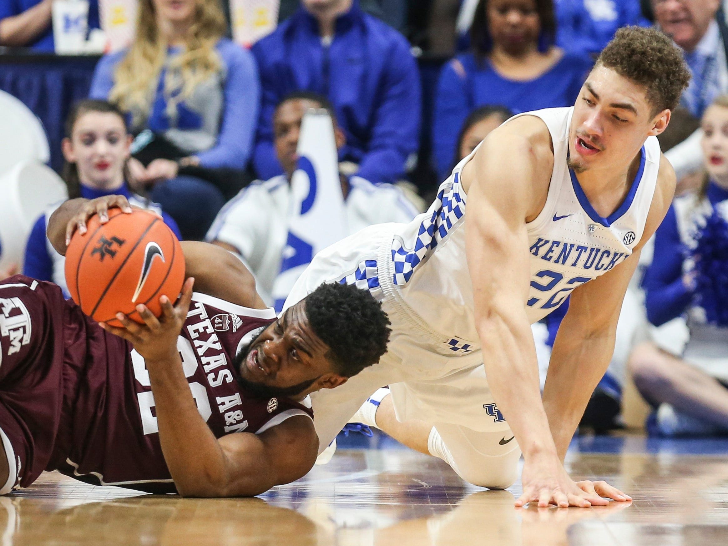 Kentucky's Reid Travis scrambled with Texas A&M's Josh Nebo Tuesday night at Rupp Arena in Lexington.