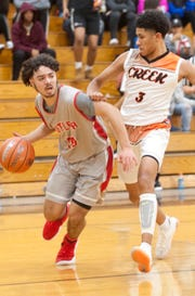 Fern Creek guard Jaden Rogers tries to cut off Butler guard Willard Minter's route to the basket.