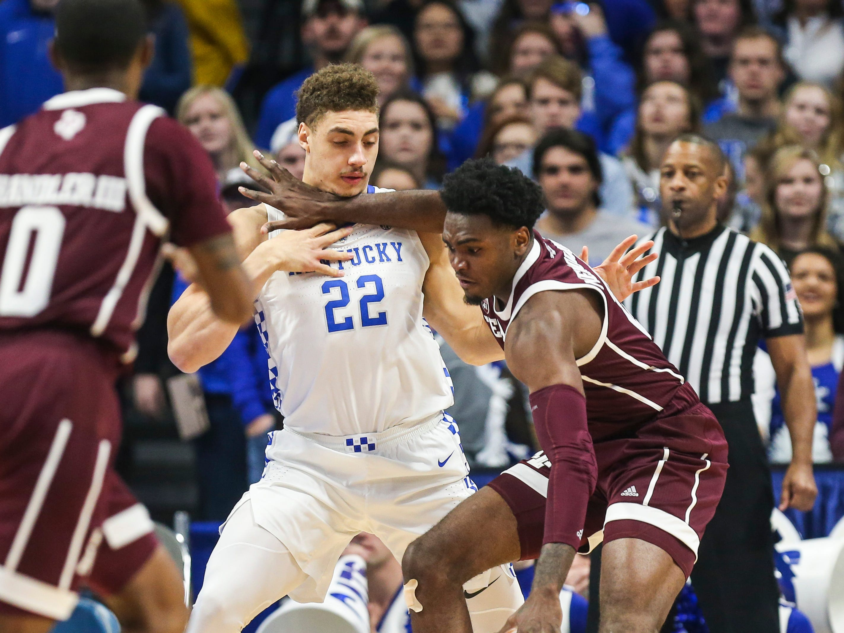 Kentucky's Reid Travis gets hit in the throat by Texas A&M's Josh Nebo Tuesday night at Rupp Arena in Lexington.