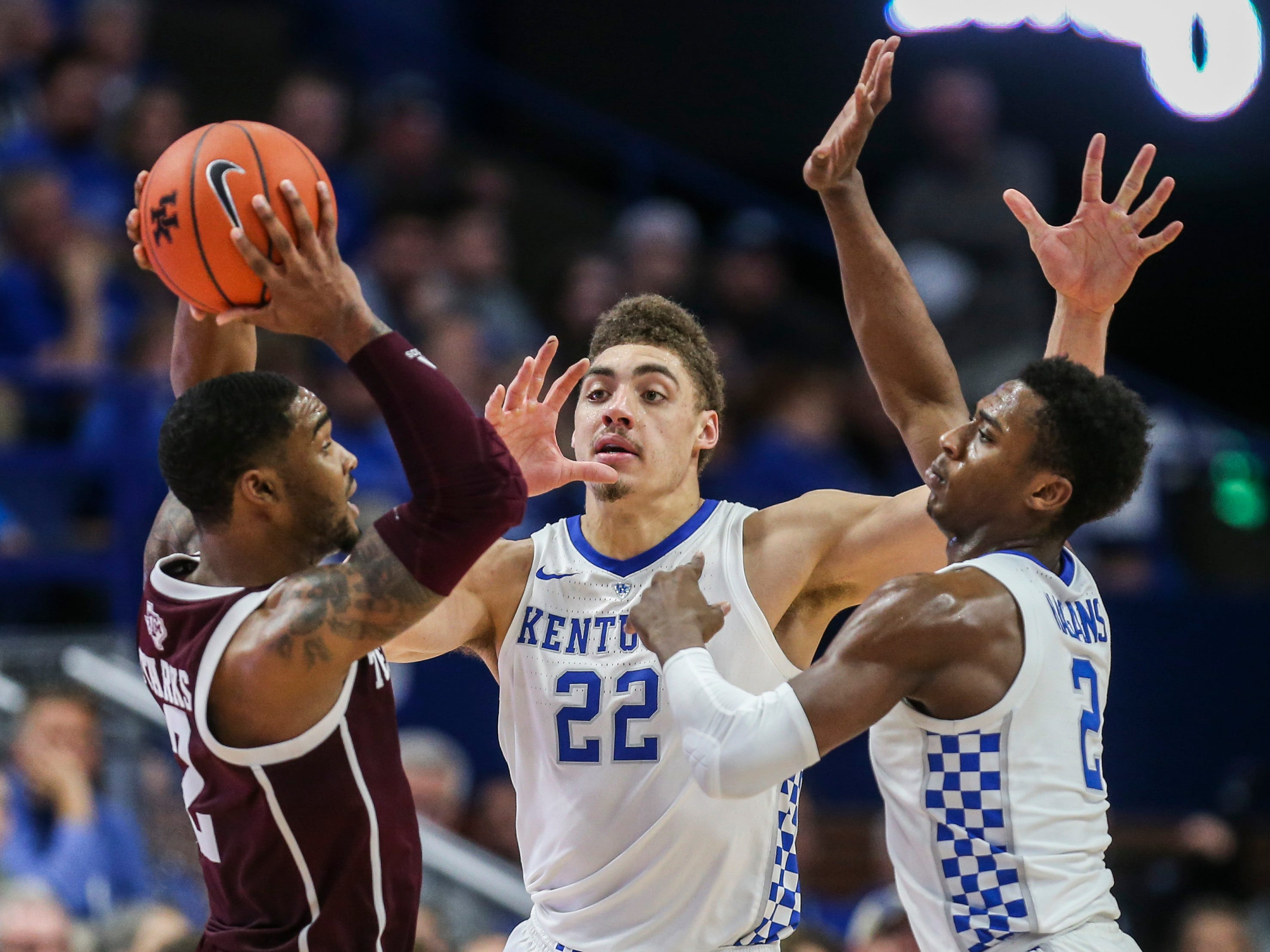Kentucky's Ashton Hagans and Reid Travis double team Texas A&M's TJ Starks in the Cats' 85-74 win Jan. 8, 2019 at Rupp Arena.