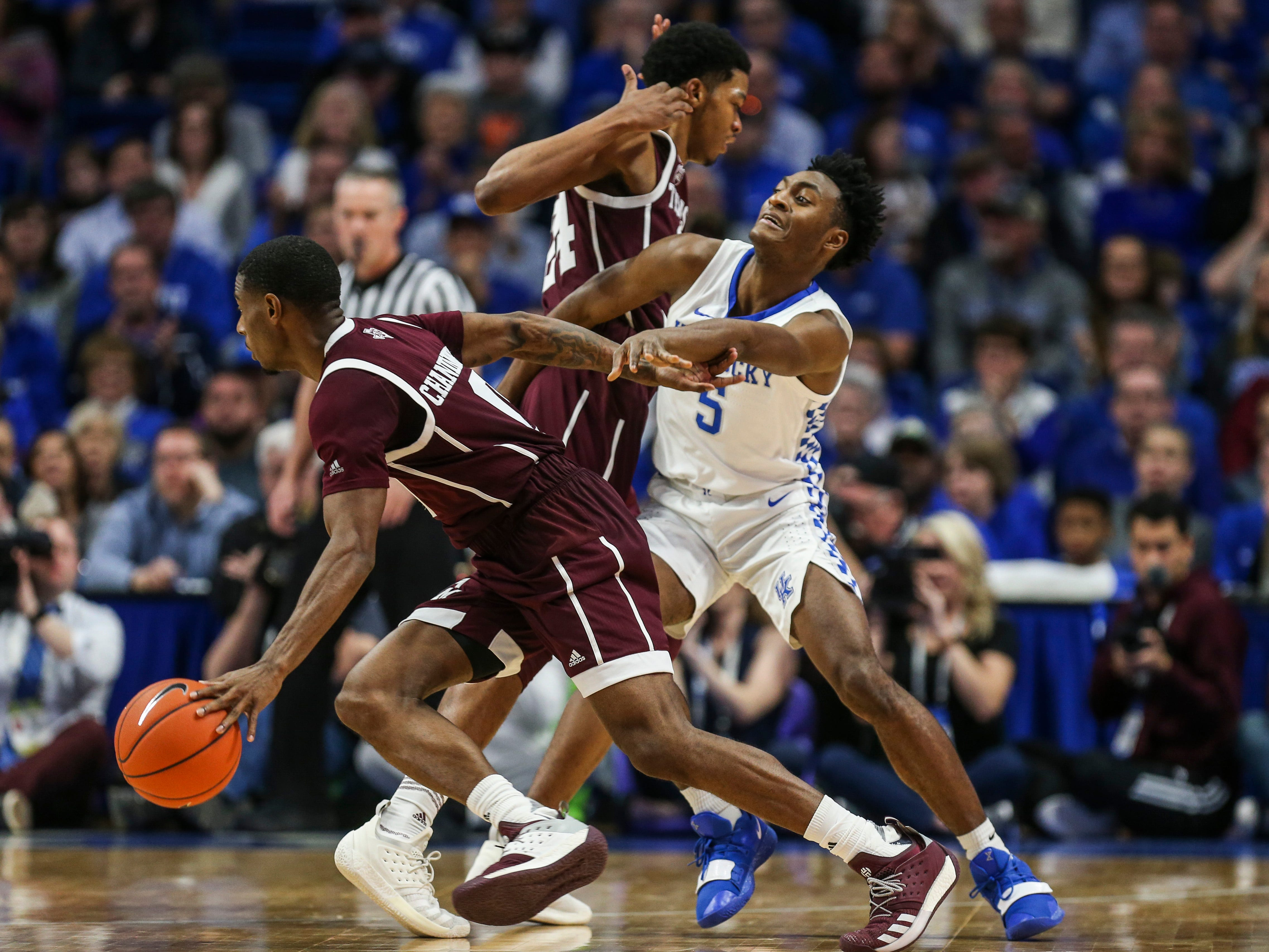 Kentucky's Immanuel Quickly gets screened by the Texas A&M offense while guarding Wendell Mitchell Jan. 8, 2019. Quickly finished with 10 points and three steals in the Cats' 85-74 win.