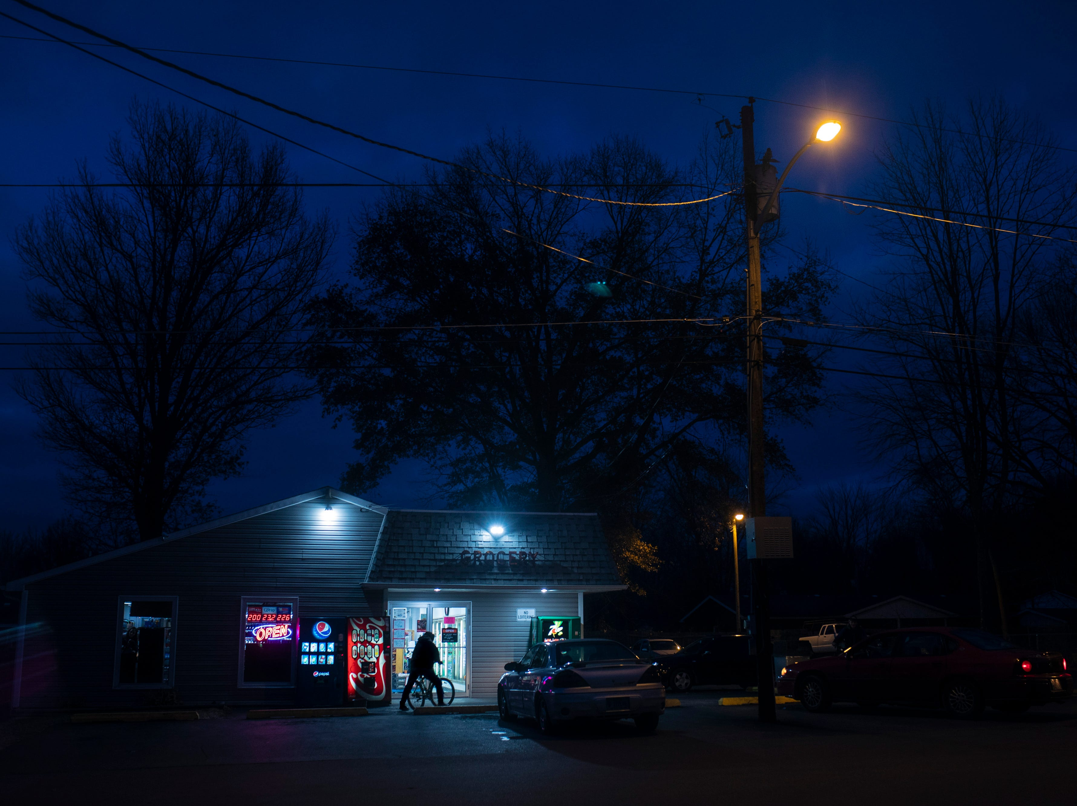 A patron parks his bicycle outside the Northside Grocery along the notorious Rural Street in Austin, Indiana. The store is a one-stop-shop in the low-income part of town most heavily hit by the drug epidemic. Bicycles are a common mode of transportation in the area where many can't afford vehicles, or other transportation. Dec. 5, 2018
