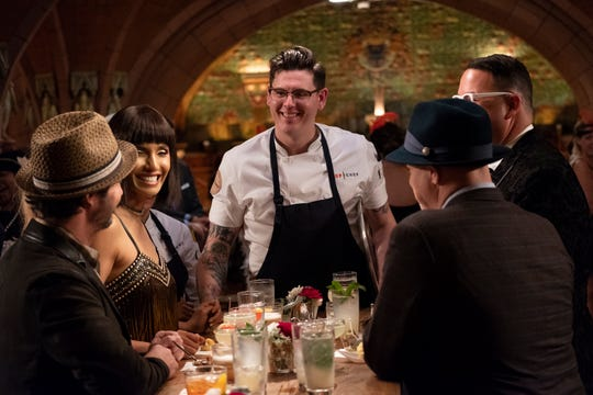 "Contestant Brian Young, center, speaks to the judges on episode 6 of Bravo's ""Top Chef: Kentucky."""