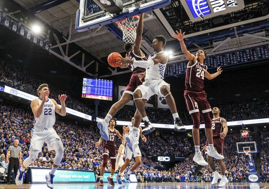 Kentucky's Ashton Hagans passes around a Texas A&M defender to Reid Travis in the second half. Hagans finished with 18 points, four assist and five steals.  January 8, 2019