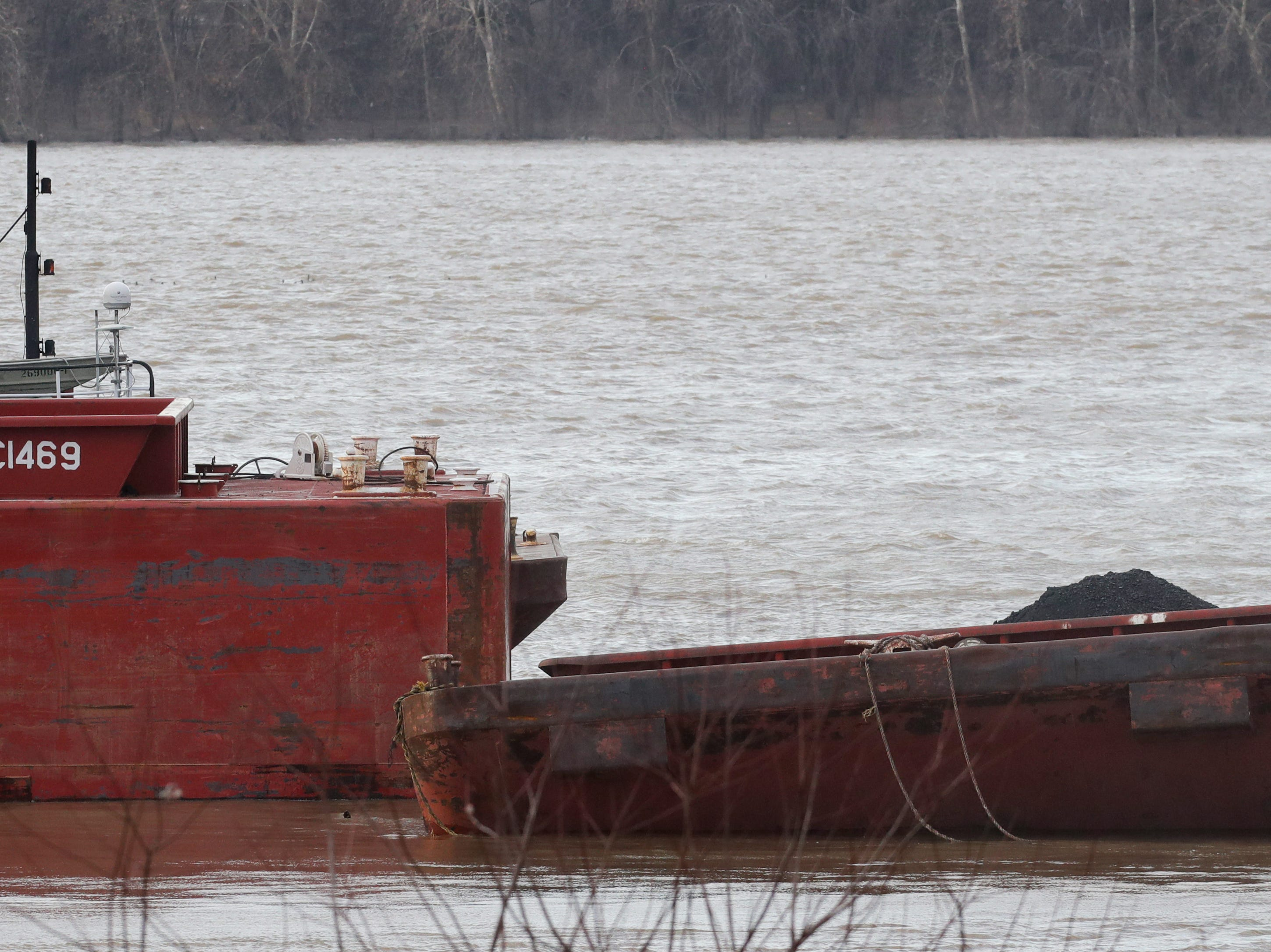 One of the salvage crews arrives at the McAlpine Dam to begin the recovery process on several barges that are stuck on the dam. 