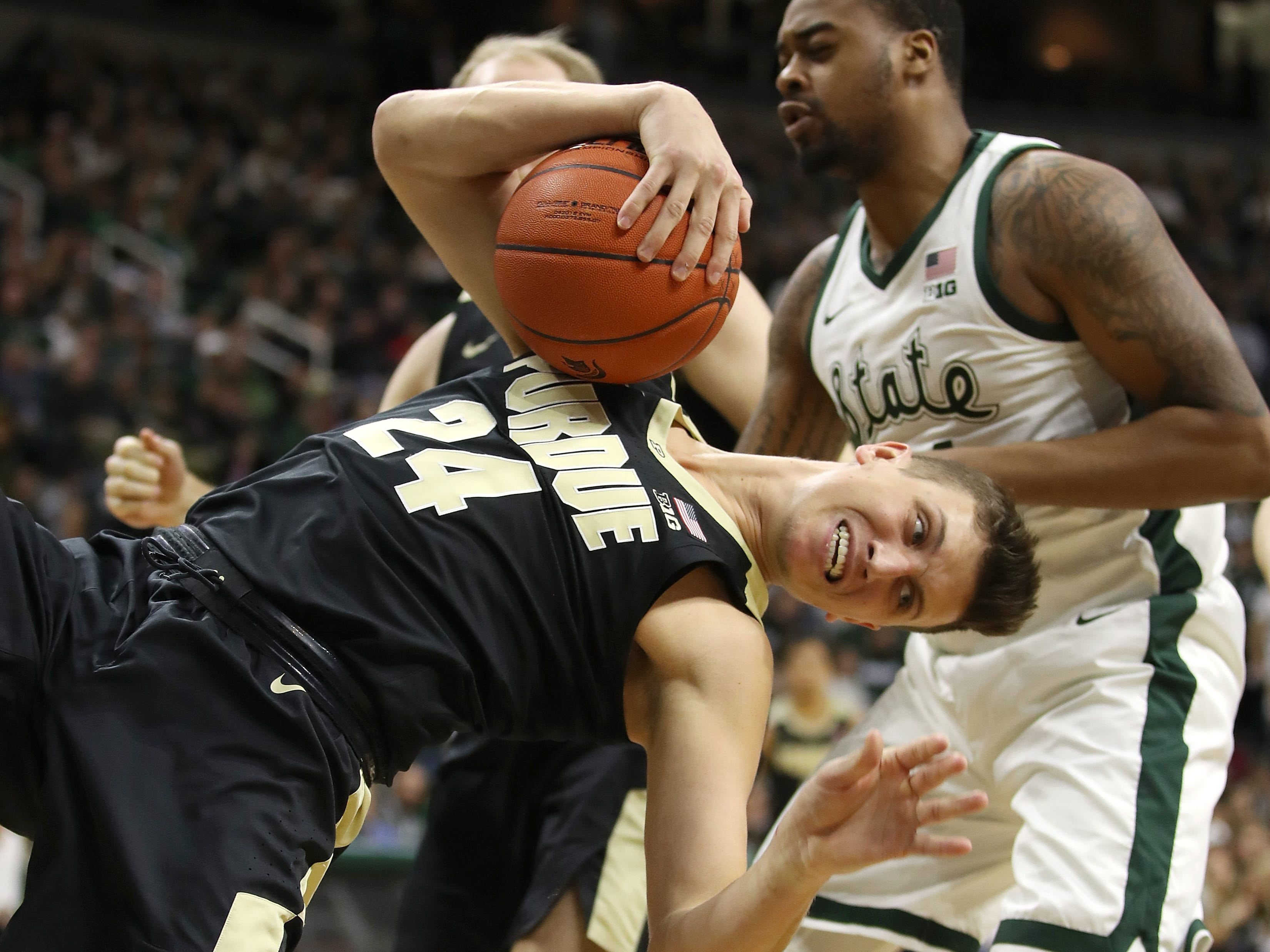 Grady Eifert #24 of the Purdue Boilermakers battles for a first half rebound with Nick Ward #44 of the Michigan State Spartans at Breslin Center on January 08, 2019 in East Lansing, Michigan.