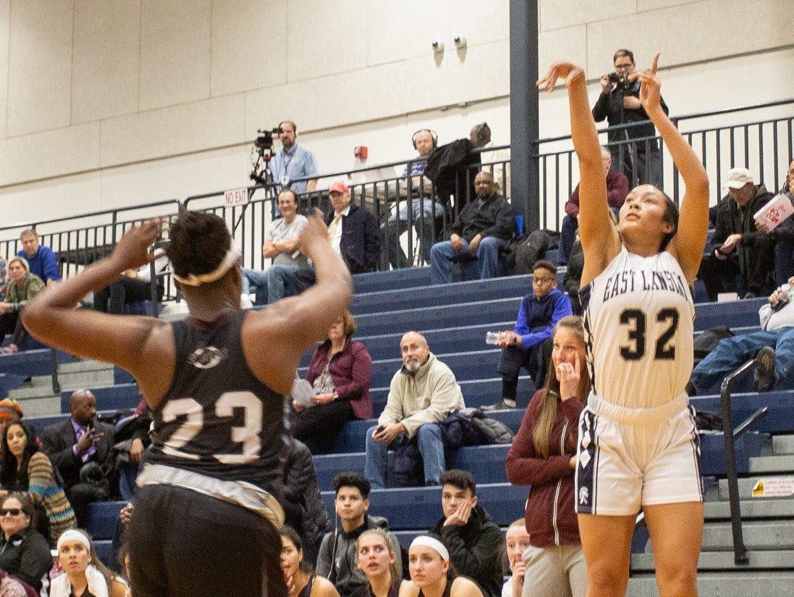 East Lansing junior Aaliyah Nye hits a 3-pointer agianst Okemos Tuesday, Jan. 8, 2019, at East Lansing High School.