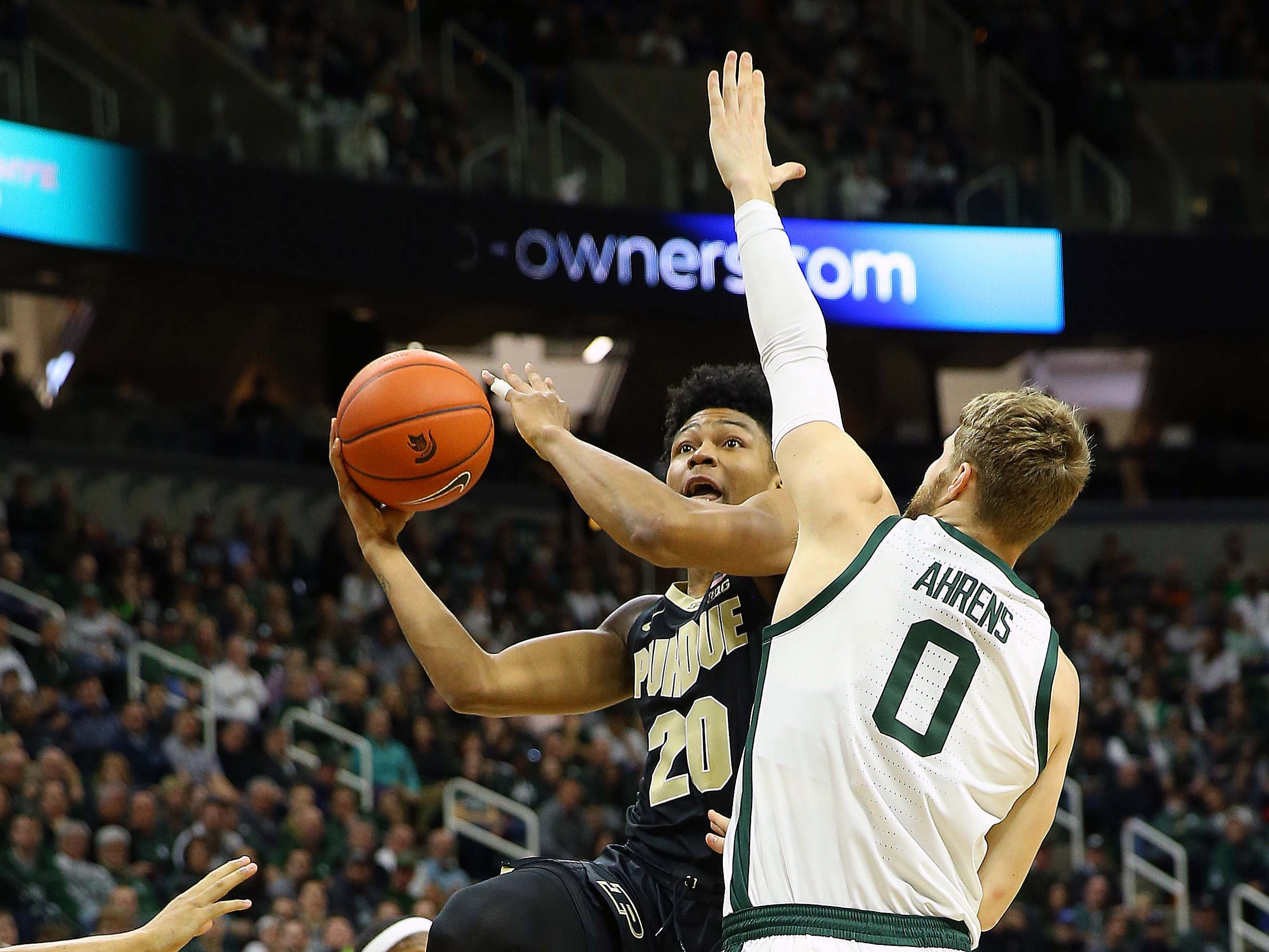 Purdue Boilermakers guard Nojel Eastern (20) drive the lane against Michigan State Spartans forward Kyle Ahrens (0) during the first half of a game at the Breslin Center.