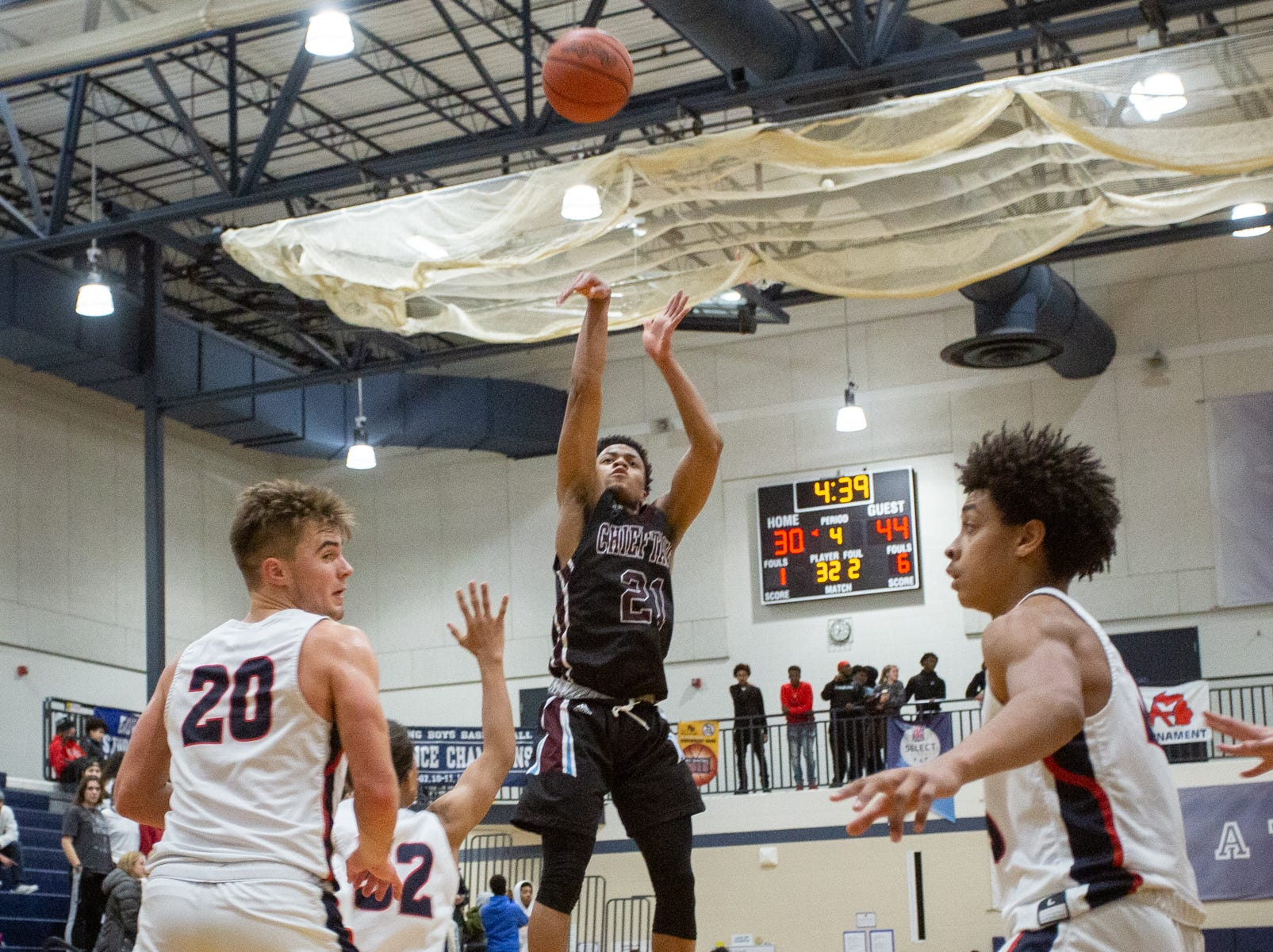 Okemos junior Noah Pruitt shoots against East Lansing on Tuesday, Jan. 8, 2019 at East Lansing High School.