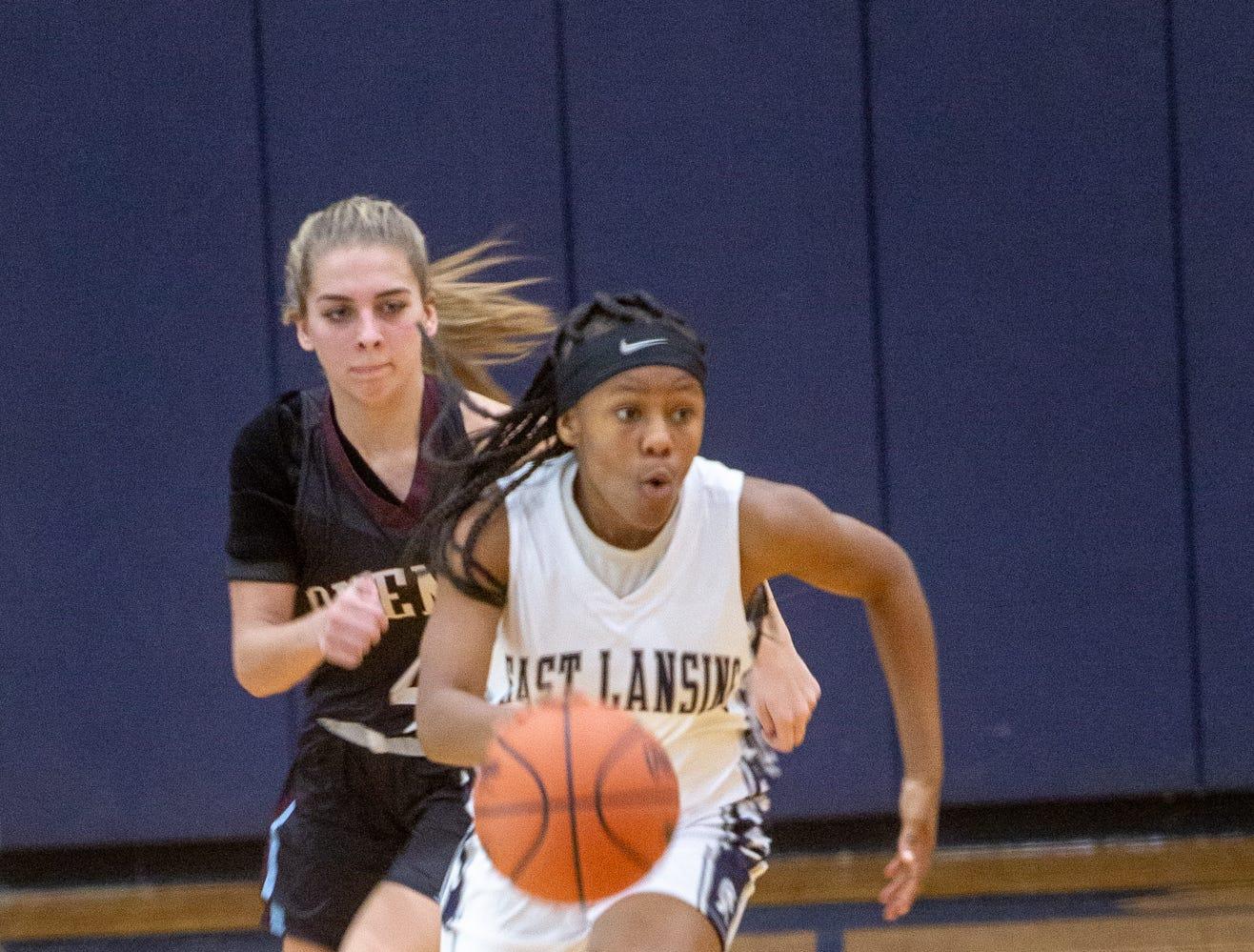 East Lansing junior, Paris Hayes brings ball down the court Tuesday, Jan. 8, 2019, at East Lansing High School.