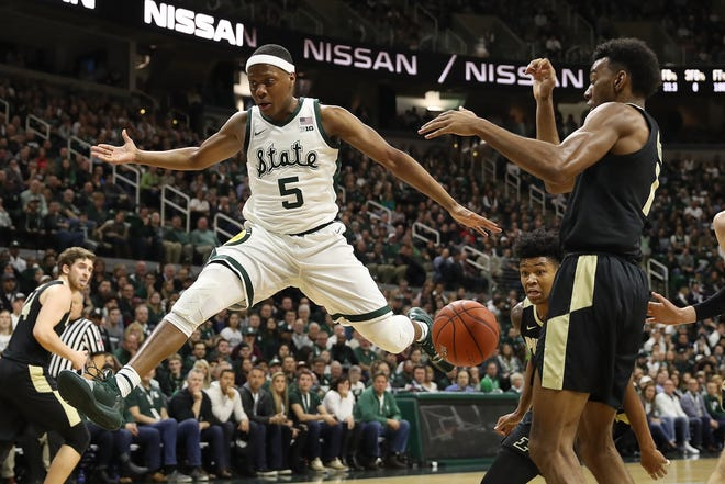 Cassius Winston #5 of the Michigan State Spartans loses control of the ball next to Aaron Wheeler #1 of the Purdue Boilermakers during the first half at Breslin Center on January 08, 2019 in East Lansing, Michigan.