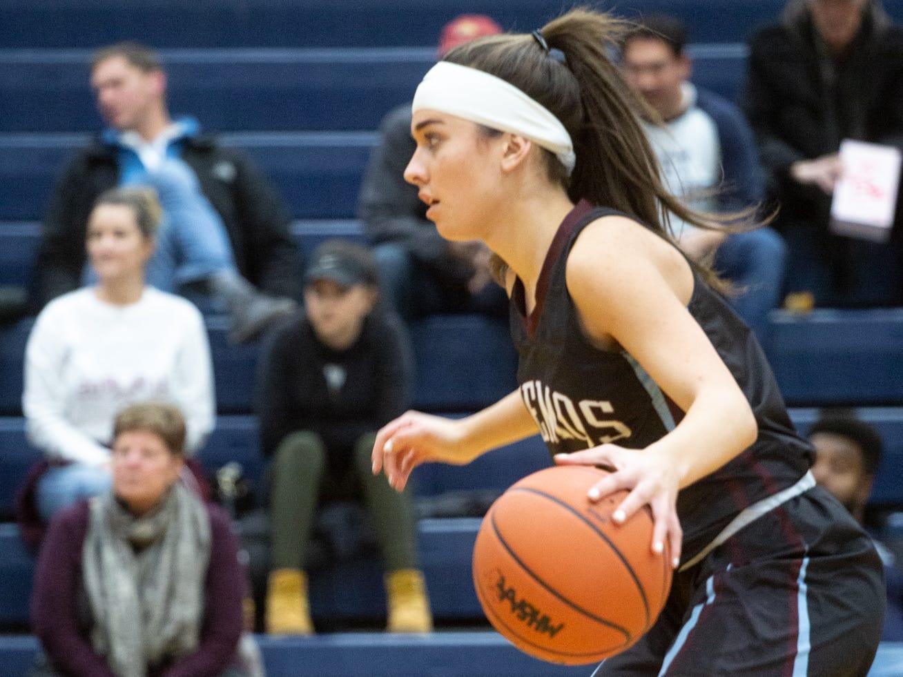 Okemos Sophomore, Lexie Sermak, brings ball down court, Tuesday, Jan. 8, 2019 at East Lansing High School.
