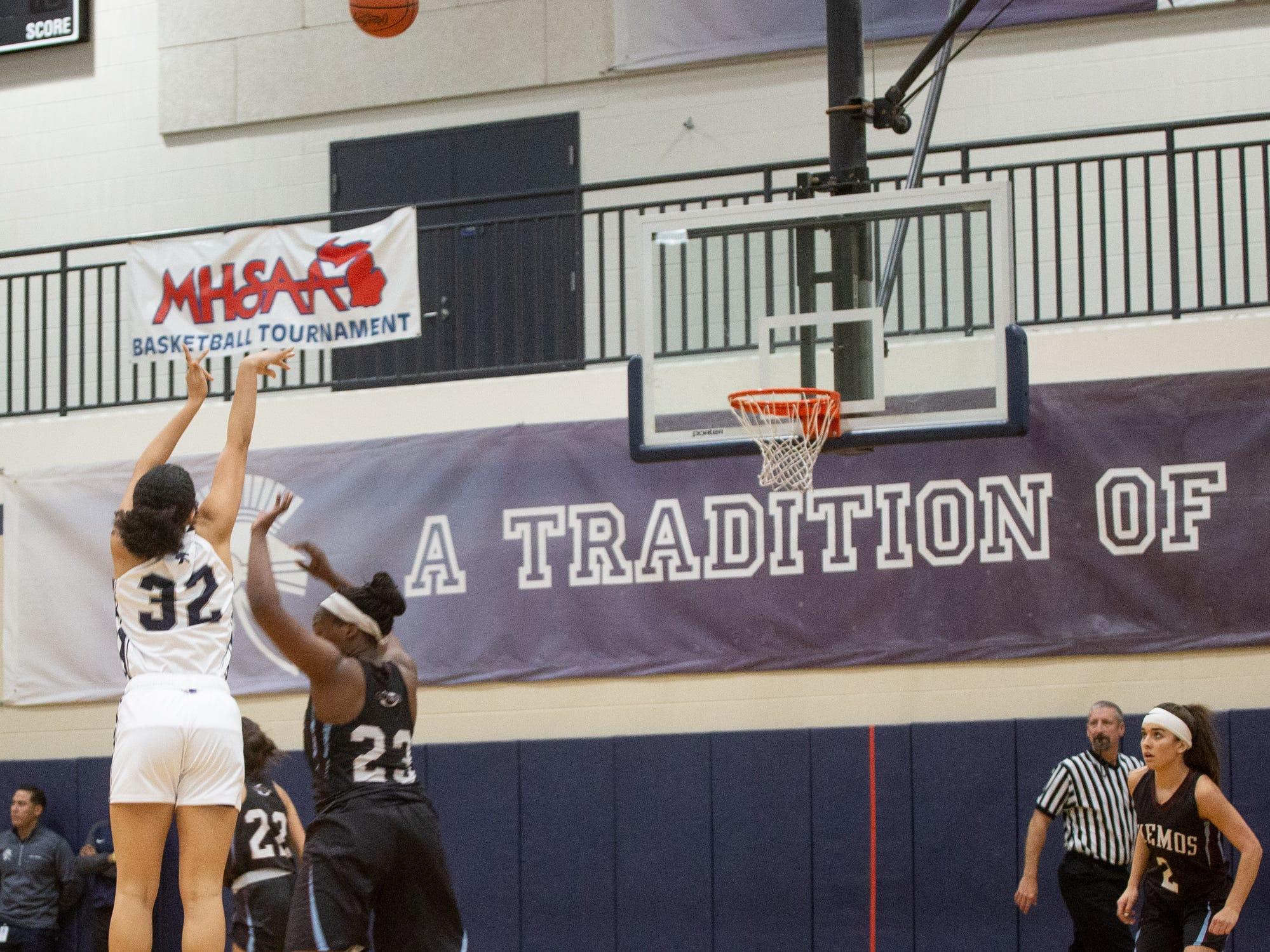 Aaliyah Nye, East Lansing Junior, hits another basket agianst Okemos Tuesday, Jan. 8, 2019, at East Lansing High School.