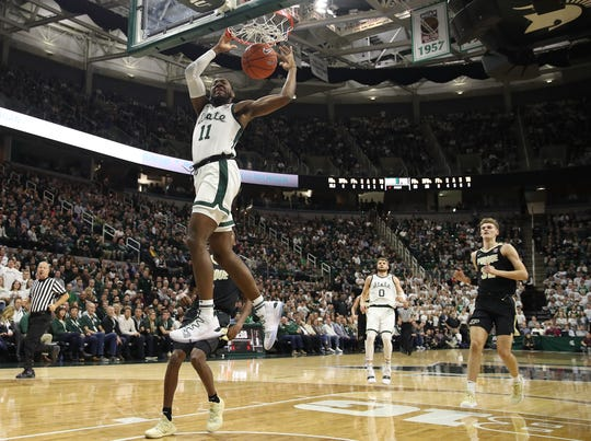 Aaron Henry #11 of the Michigan State Spartans dunks in the first half while playing the Purdue Boilermakers at Breslin Center on January 08, 2019 in East Lansing, Michigan.