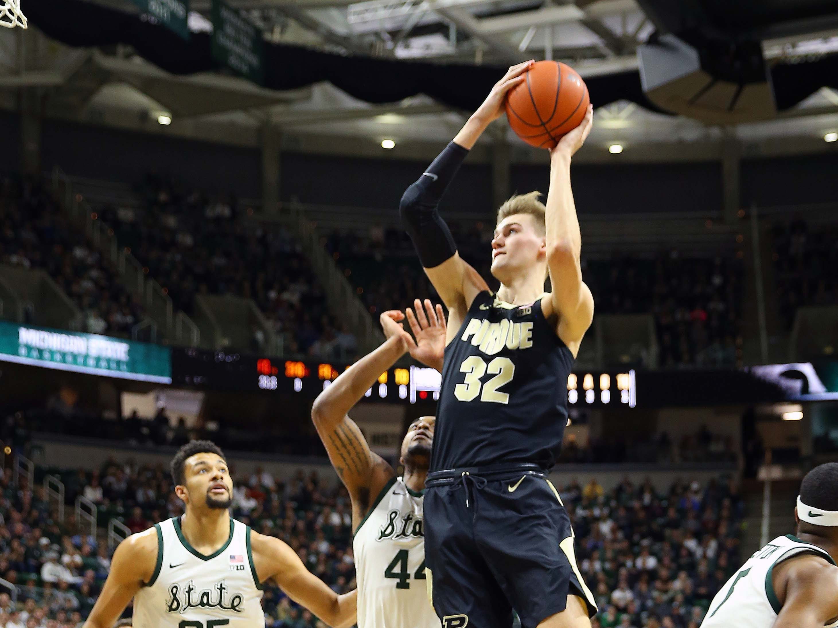 Purdue Boilermakers center Matt Haarms (32) lays the ball up in front of Michigan State Spartans forward Nick Ward (44) during the first half of a game at the Breslin Center.