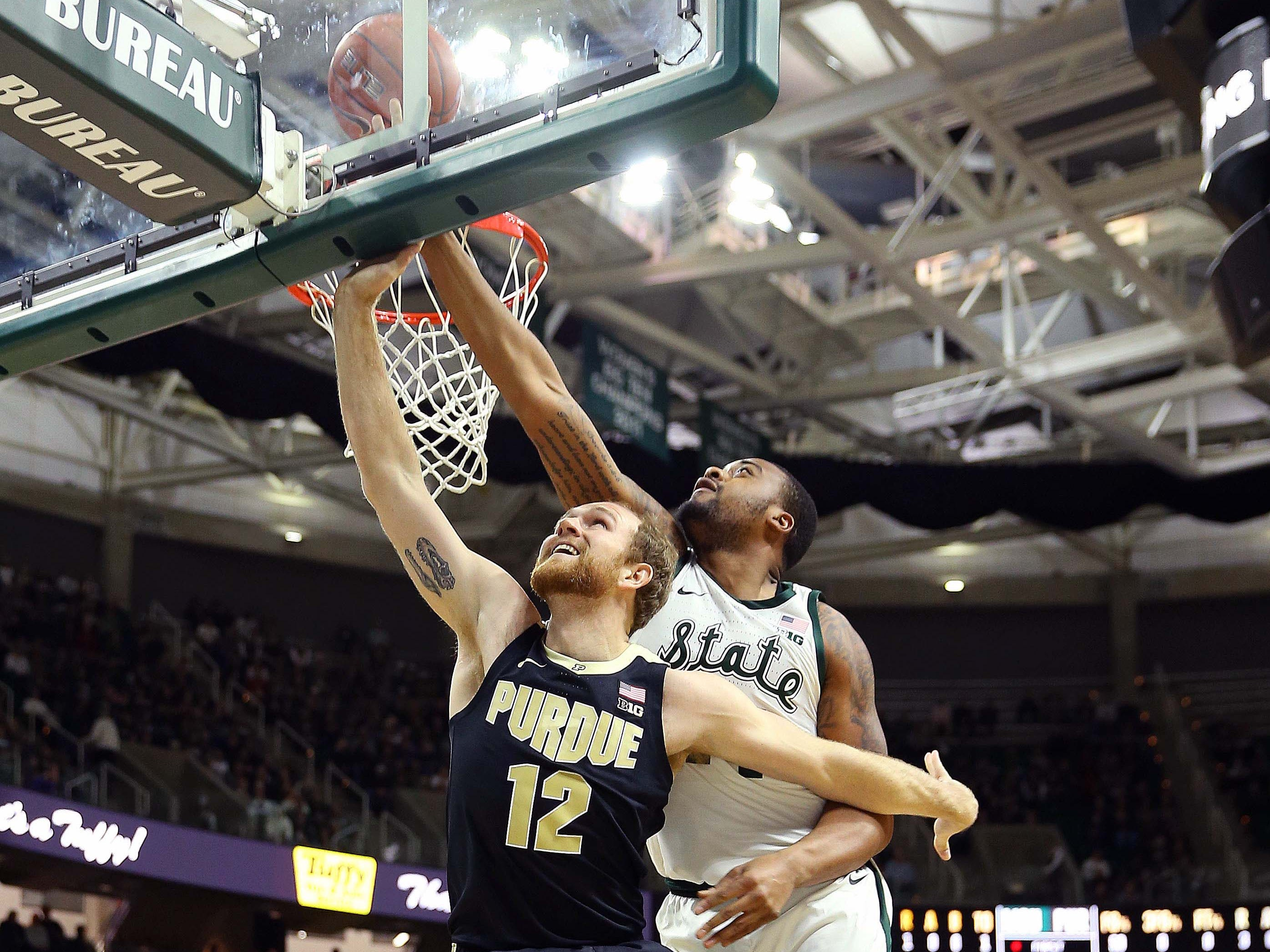 Purdue Boilermakers forward Evan Boudreaux (12) lays the ball up in front of Michigan State Spartans forward Nick Ward (44) during the first half of a game at the Breslin Center.