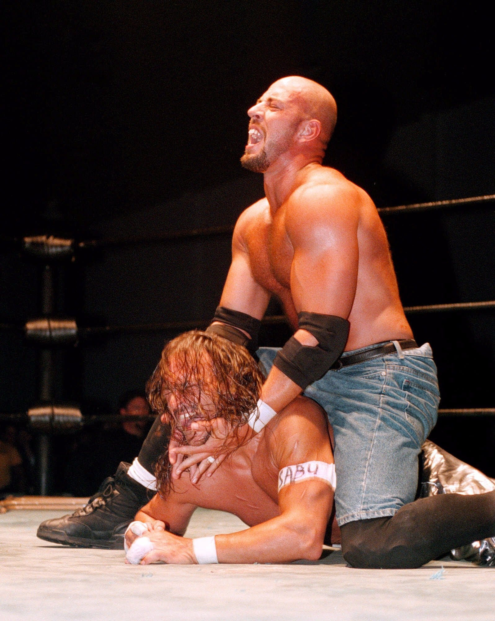 Wrestler Justin Credible puts a choke hold on his opponent Sabu during a 2009 Extreme Championship Wrestling match in Orlando. Sabu, whose real name is Terry Brunk, grew up in Lansing.
