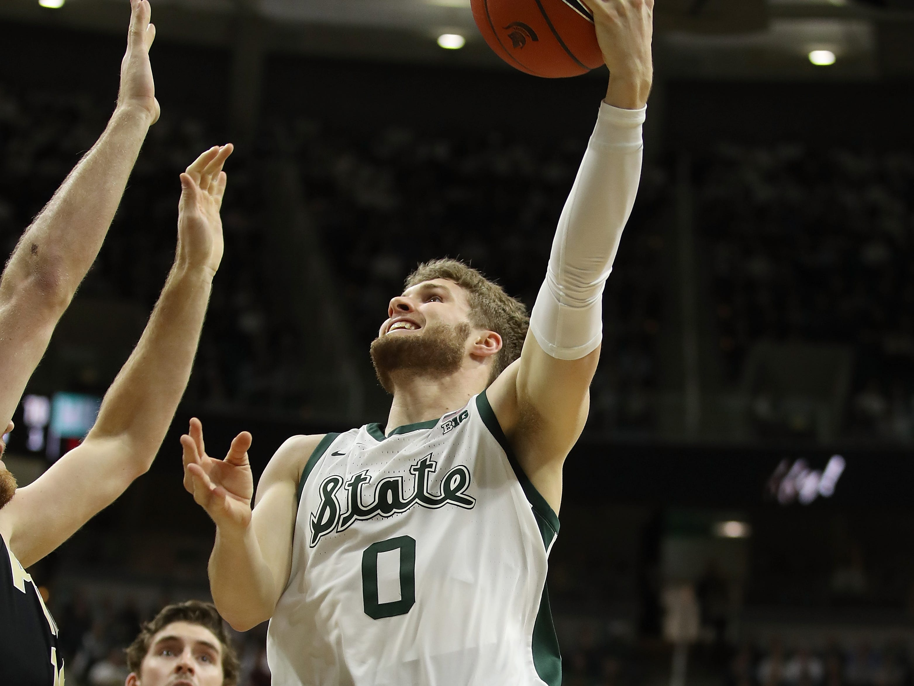 Kyle Ahrens #0 of the Michigan State Spartans gets a first half shot off while playing the Purdue Boilermakers at Breslin Center on January 08, 2019 in East Lansing, Michigan.