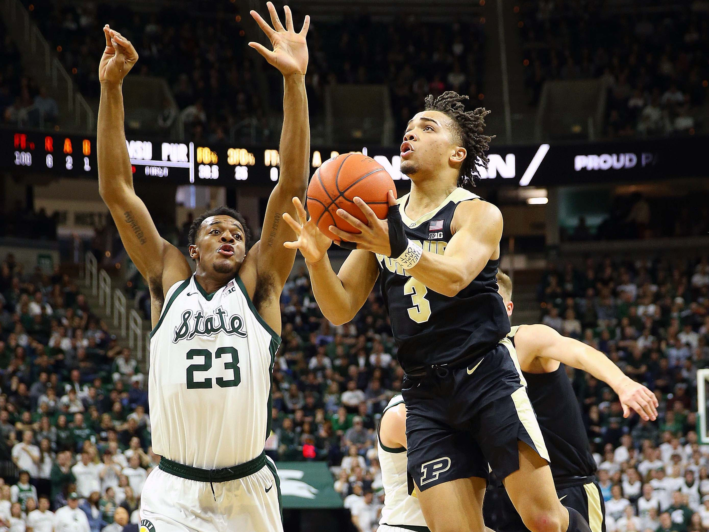Purdue Boilermakers guard Carsen Edwards (3) drives the lane in front of Michigan State Spartans forward Xavier Tillman (23) during the first half of a game at the Breslin Center.