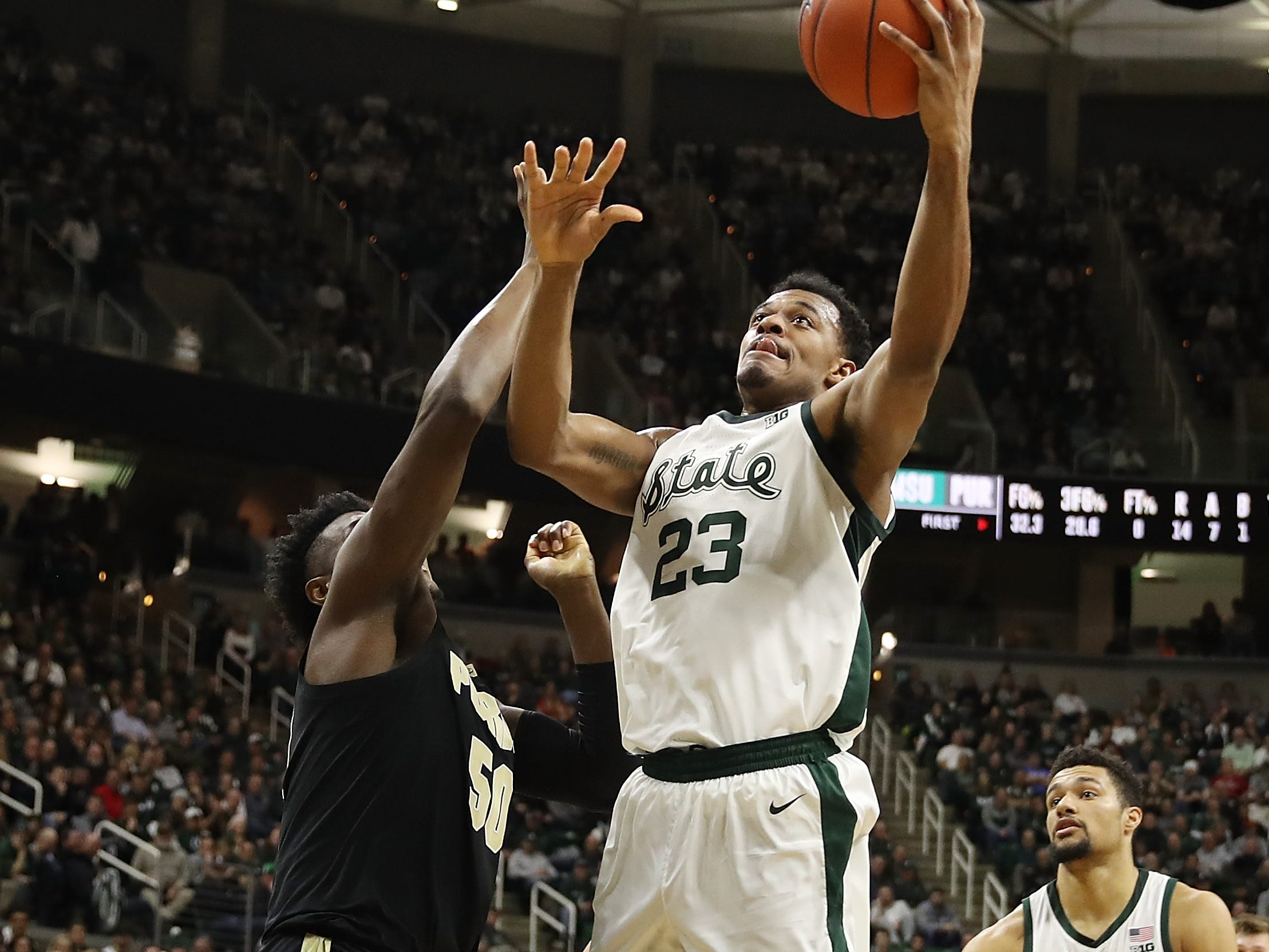 Xavier Tillman #23 of the Michigan State Spartans gets a shot off next to Trevion Williams #50 of the Purdue Boilermakers during the first half at Breslin Center on January 08, 2019 in East Lansing, Michigan.