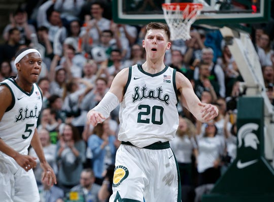 Michigan State's Matt McQuaid, right, and Cassius Winston celebrate during a bucket by McQuaid during Tuesday night's 77-59 win over Purdue at Breslin Center.
