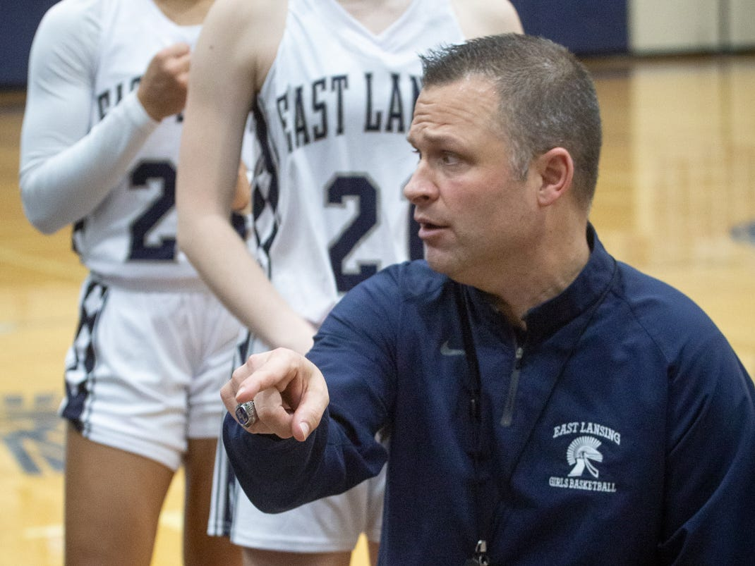 East Lansing Head Coach, Rob Smith, talks stategy during time out Tuesday, Jan. 8, 2019, at East Lansing High School.