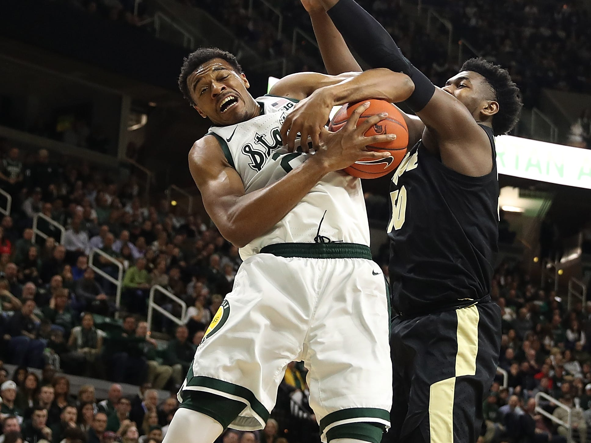 Xavier Tillman #23 of the Michigan State Spartans grabs a first half rebound next to Trevion Williams #50 of the Purdue Boilermakers at Breslin Center on January 08, 2019 in East Lansing, Michigan.