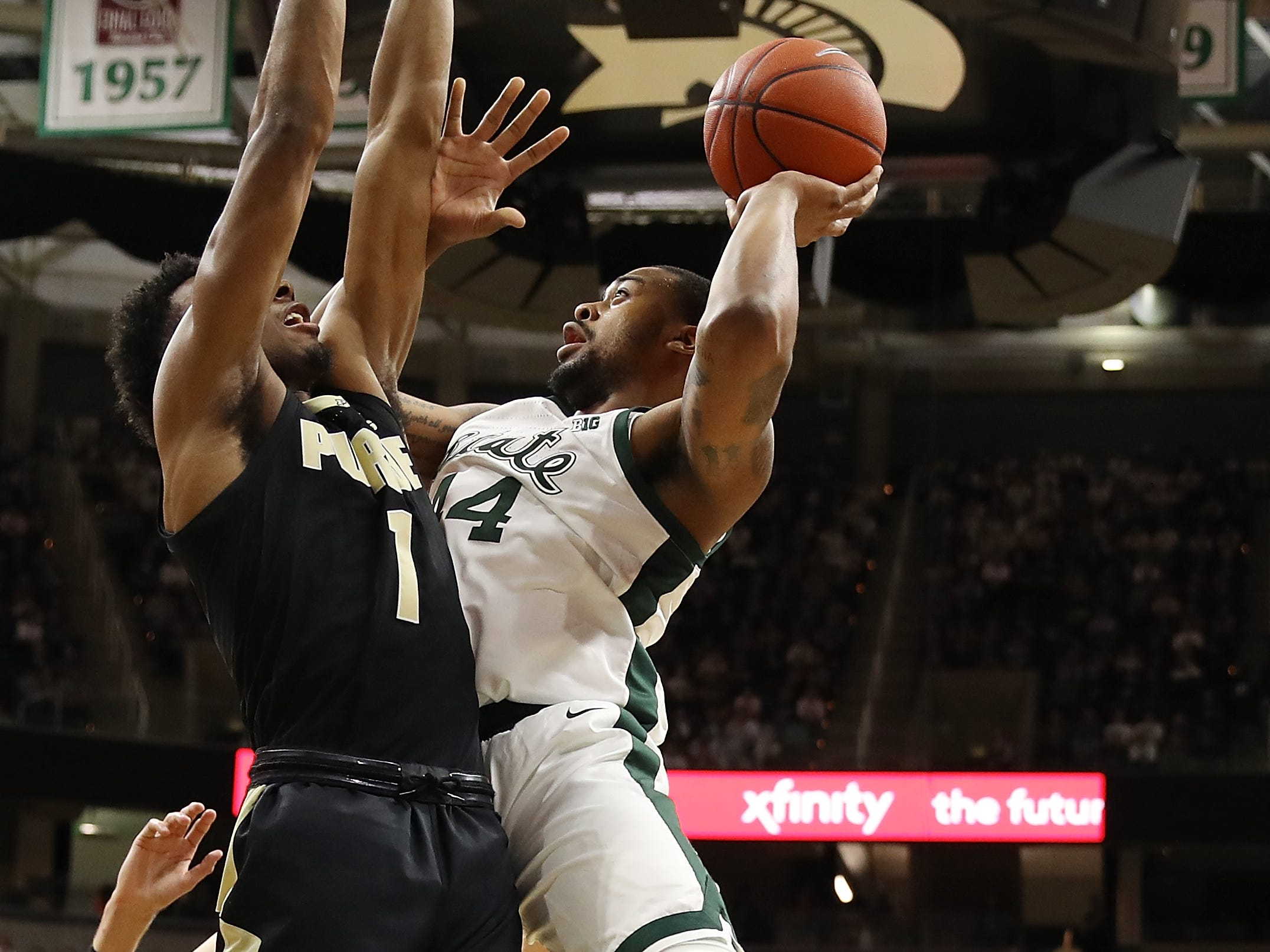 Nick Ward #44 of the Michigan State Spartans gets a shot off over Aaron Wheeler #1 of the Purdue Boilermakers during the first half at Breslin Center on January 08, 2019 in East Lansing, Michigan.