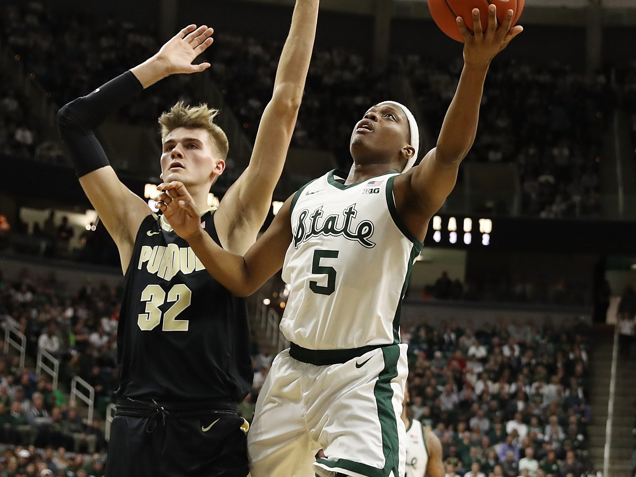 Cassius Winston #5 of the Michigan State Spartans drives to the basket past Matt Haarms #32 of the Purdue Boilermakers during the first half at Breslin Center on January 08, 2019 in East Lansing, Michigan.