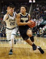 Purdue star Carsen Edwards is defended by MSU's Matt McQuaid, who helped hold Edwards to 11 points on 3-for-16 shooting Tuesday night.