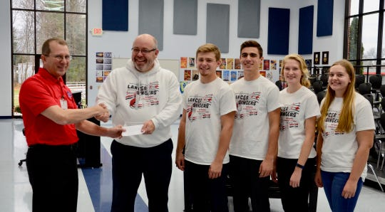 Joel Ungemach (left), music director at Manitowoc Lutheran High School, and Don Lewellen from Clipper City Chordsmen.