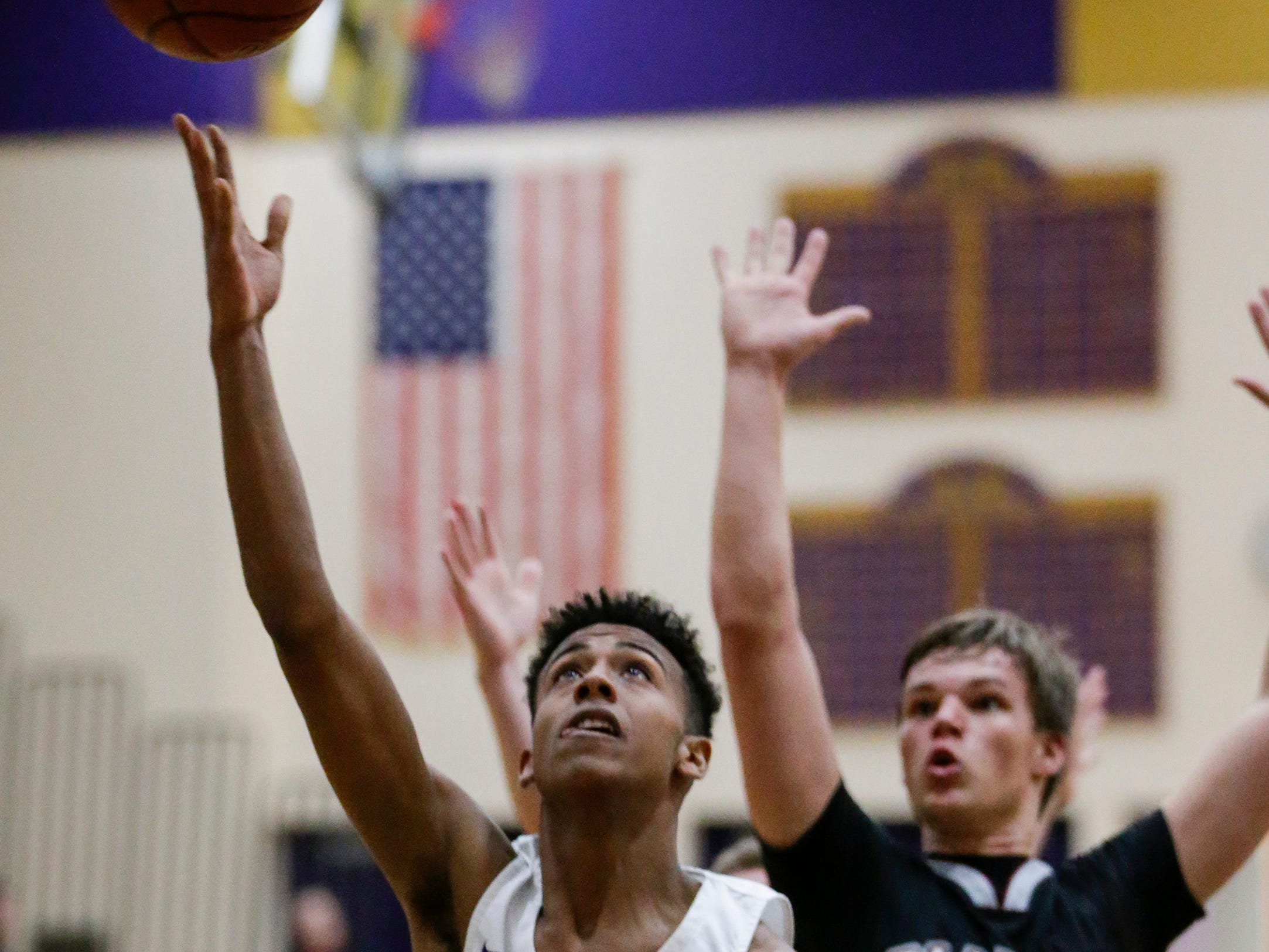 Two Rivers' Isaac Coronado shoots a layup against Green Bay NEW Lutheran at Two Rivers High School Tuesday, January 8, 2019, in Two Rivers, Wis. Joshua Clark/USA TODAY NETWORK-Wisconsin