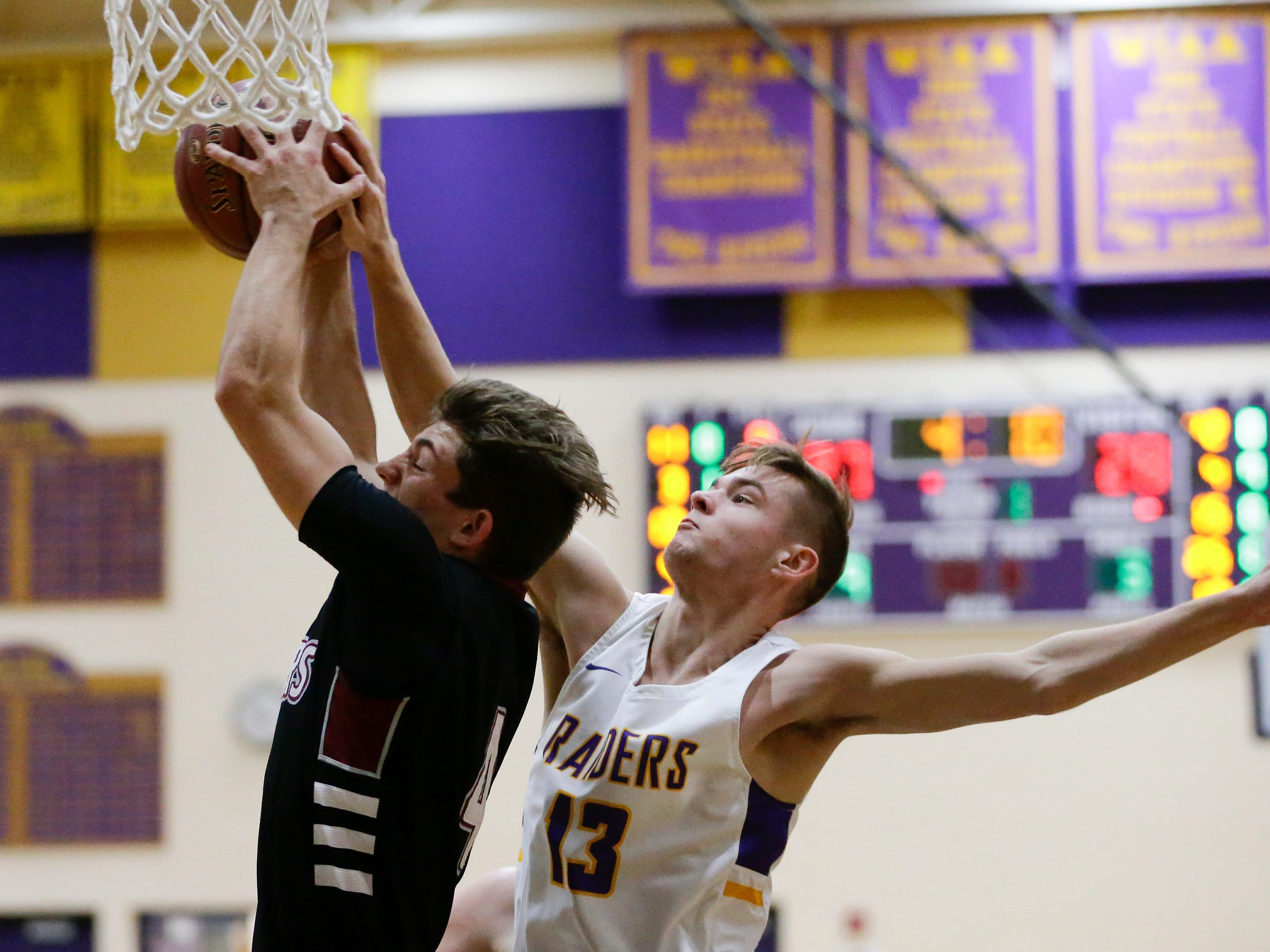 Two Rivers' David Tice goes up for a rebound against Green Bay NEW Lutheran at Two Rivers High School Tuesday, January 8, 2019, in Two Rivers, Wis. Joshua Clark/USA TODAY NETWORK-Wisconsin
